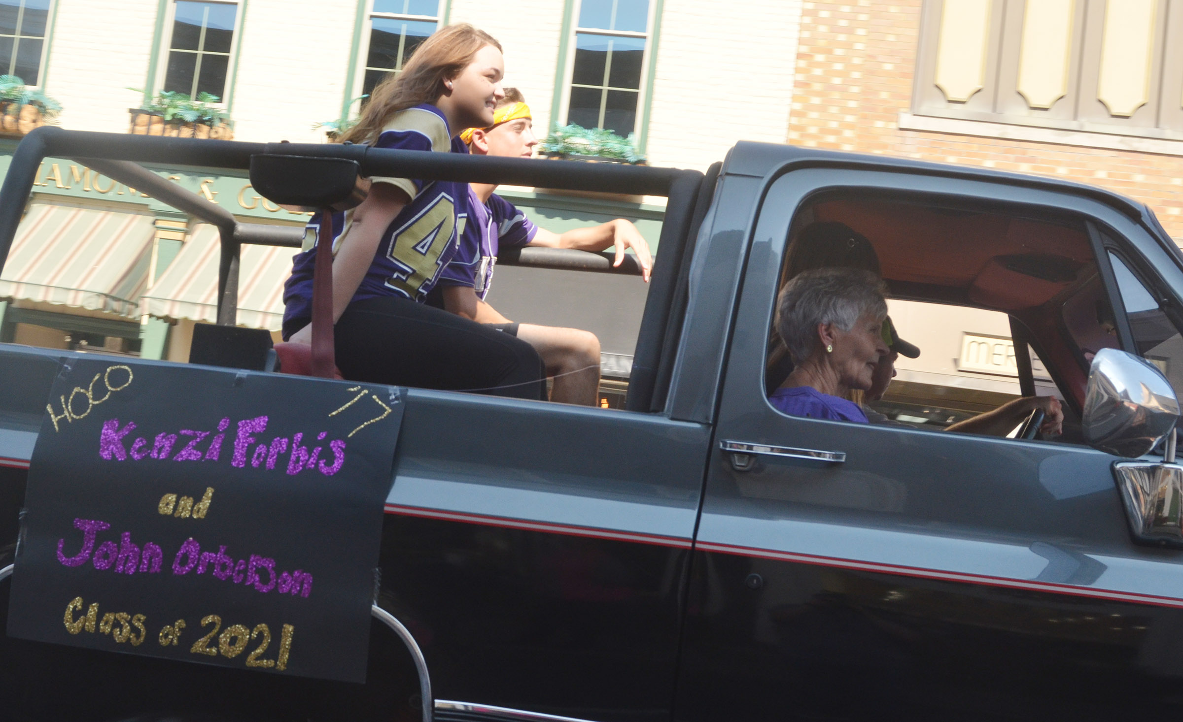 CHS freshmen homecoming candidates Kenzi Forbis and John Orberson ride in the parade.