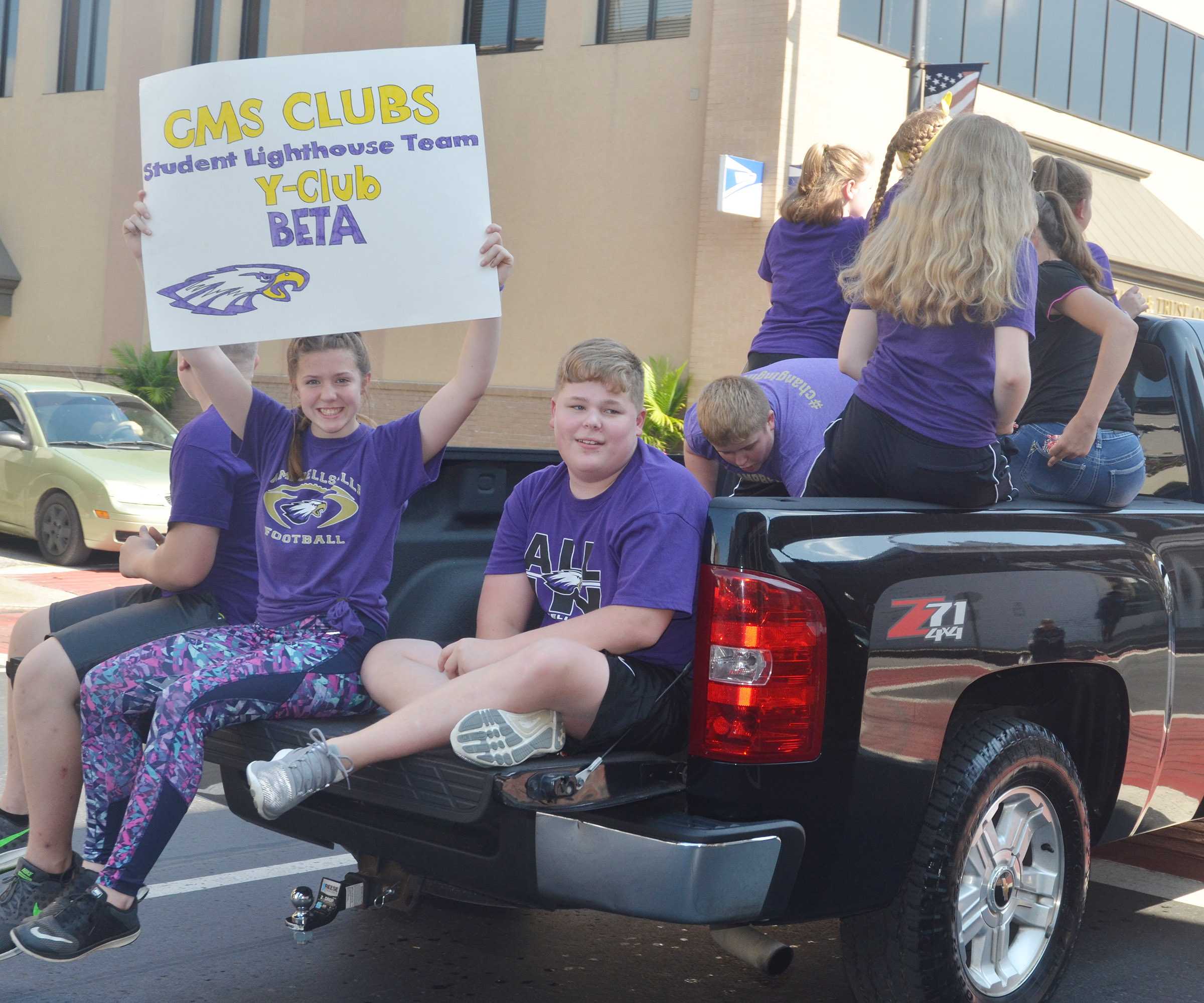 CMS Y-Club, Beta and Student Lighthouse team members ride in the parade.