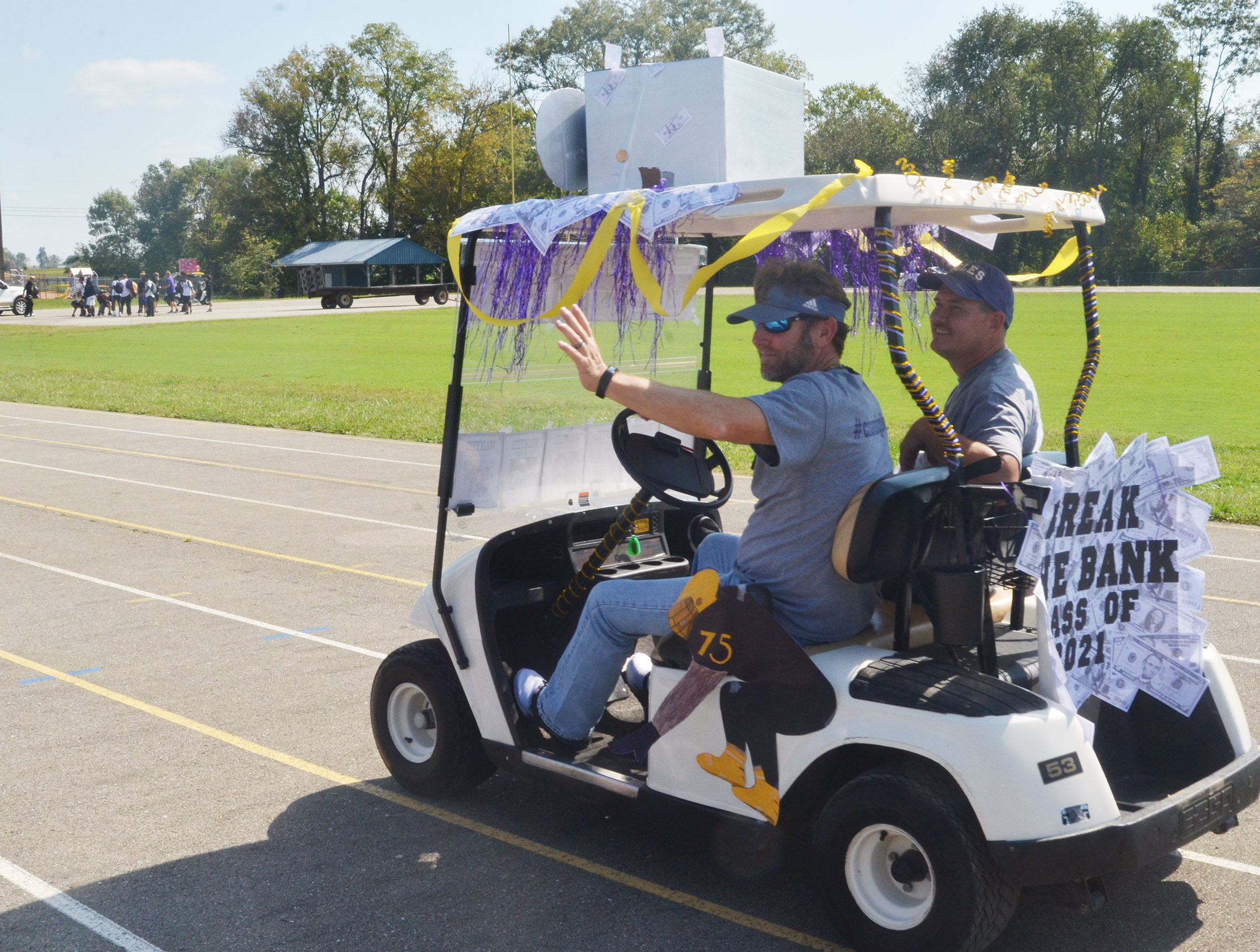 CHS teacher Herb Wiseman, at left, and custodian David Mardis ride in the parade.