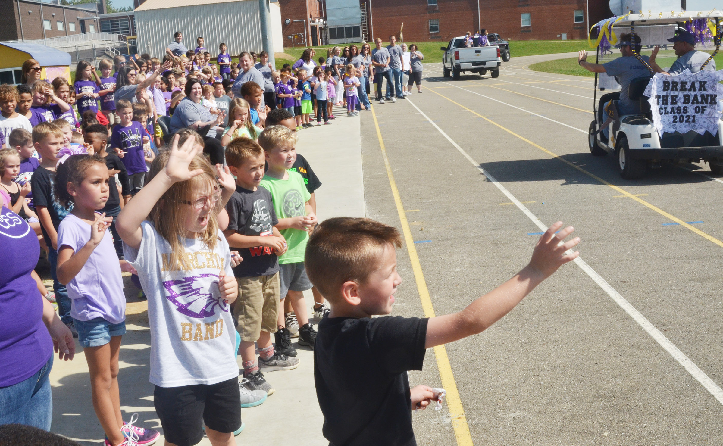 CES students wave to those riding in the parade.