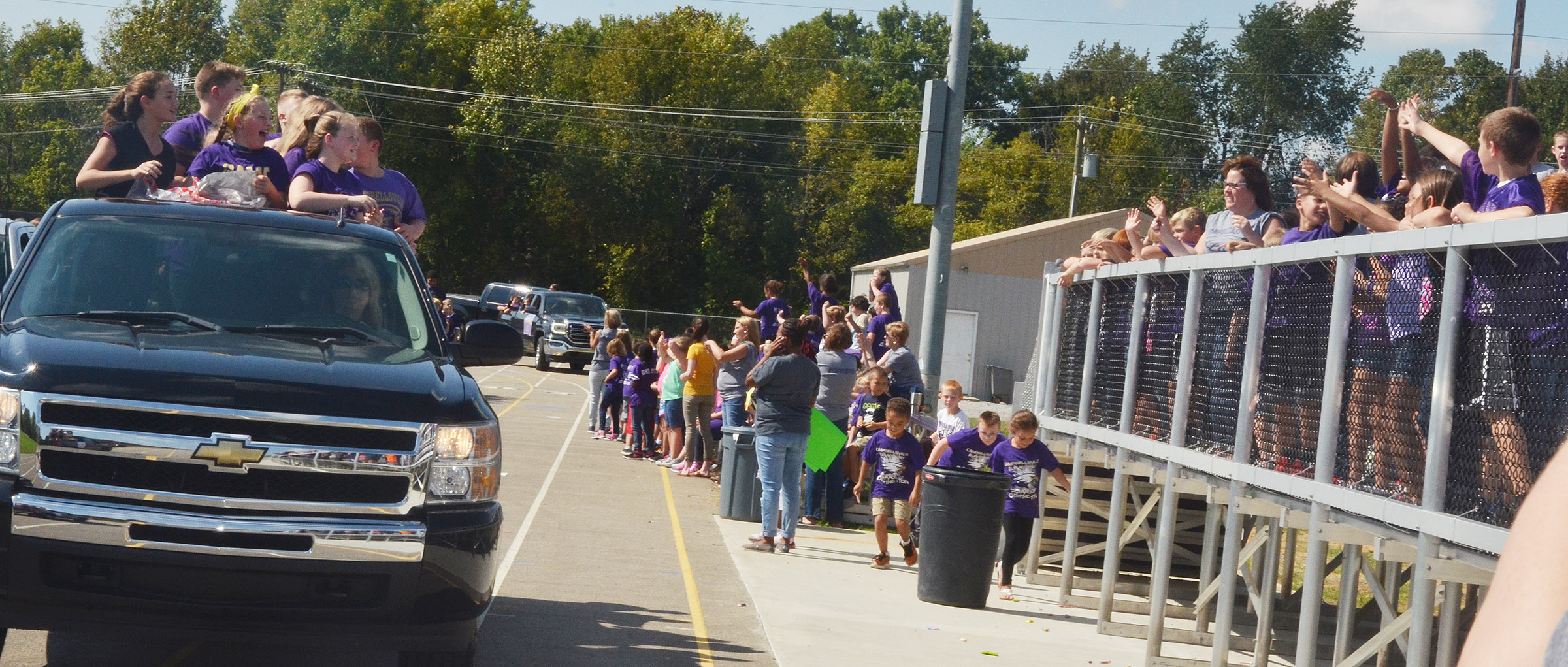 CES students wave to those in the parade.