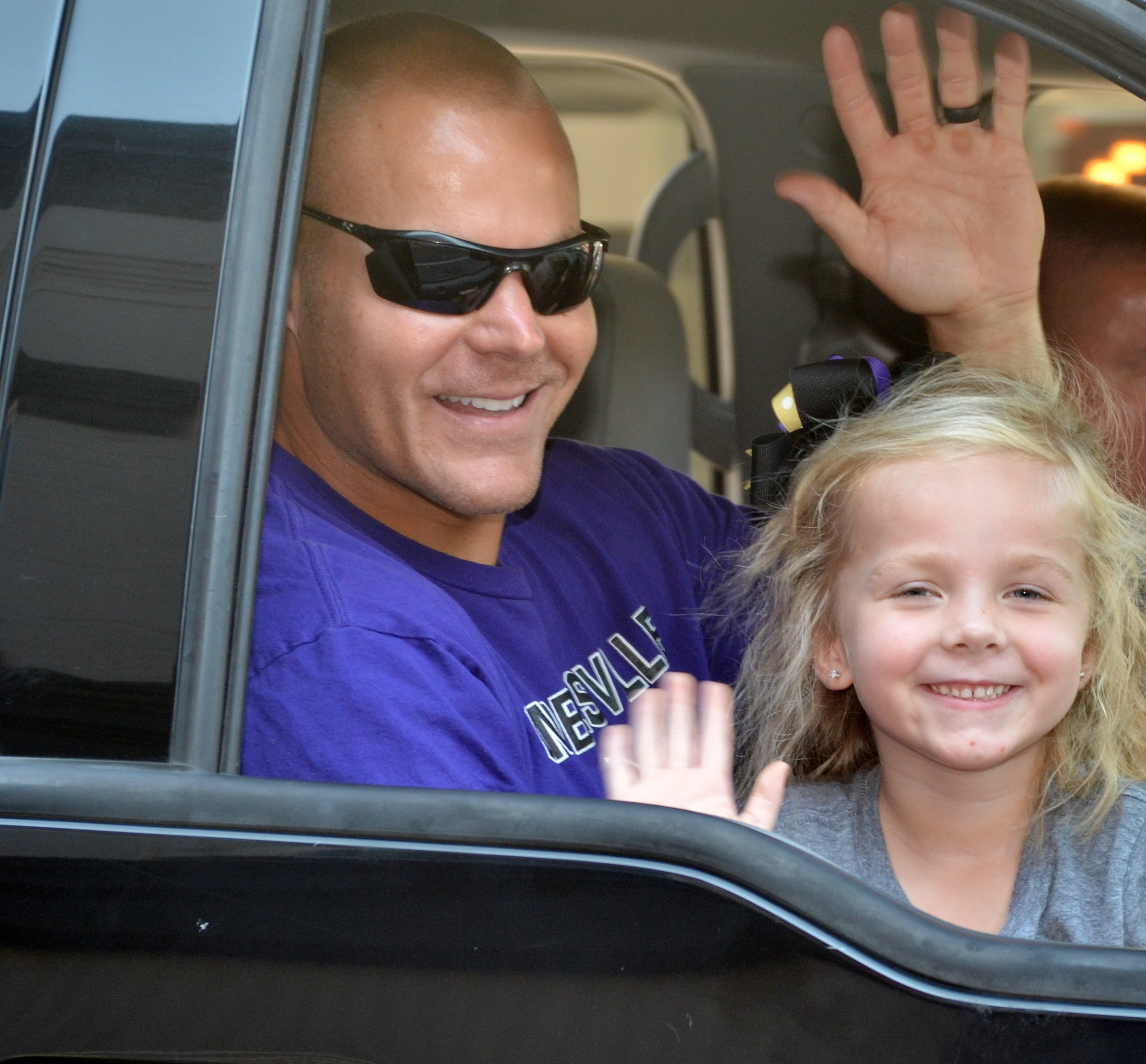 CHS assistant football coach Robbie Gribbins waves with his daughter, Trinidy, who is a kindergartener at Campbellsville Elementary School.