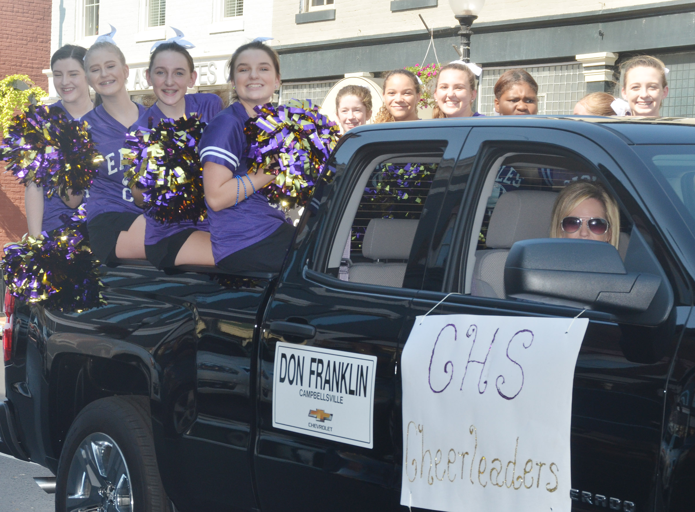 CHS cheerleaders ride in the parade.