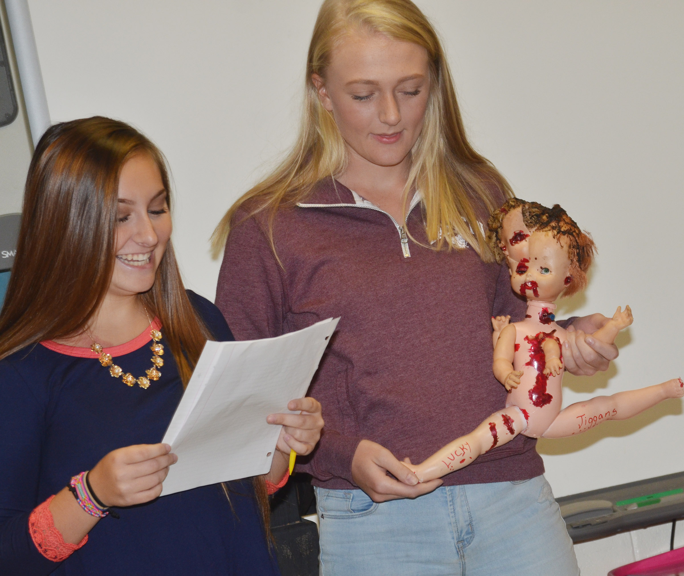 CHS juniors Reagan Knight, at left, and Abbie Dicken present their monster.