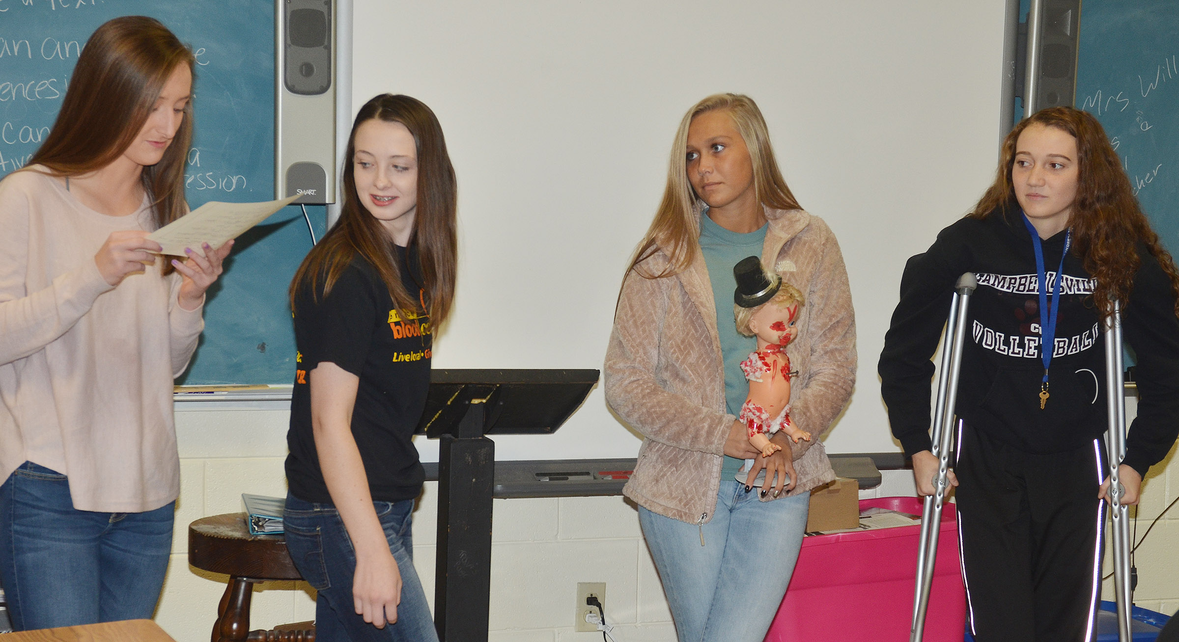 CHS juniors, from left, Samantha Mason, Caleigh Bright, Tatem Wiseman and Salena Ritchie present their monster to their classmates.