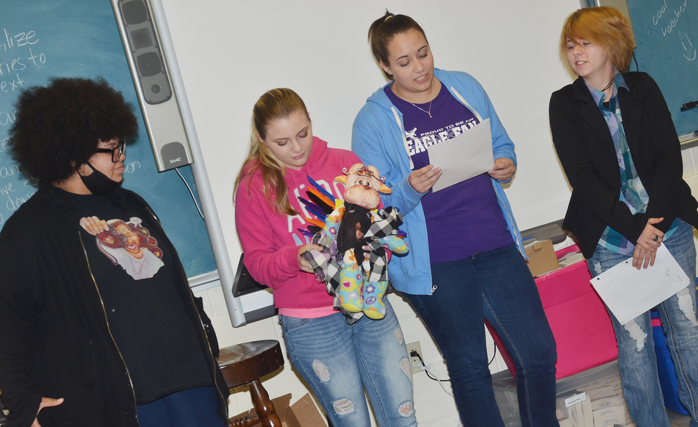 CHS juniors, from left, Jaylah Tucker, Hayley Stapleton, Elizabeth Sullivan and Christina Phipps talk about their monster.
