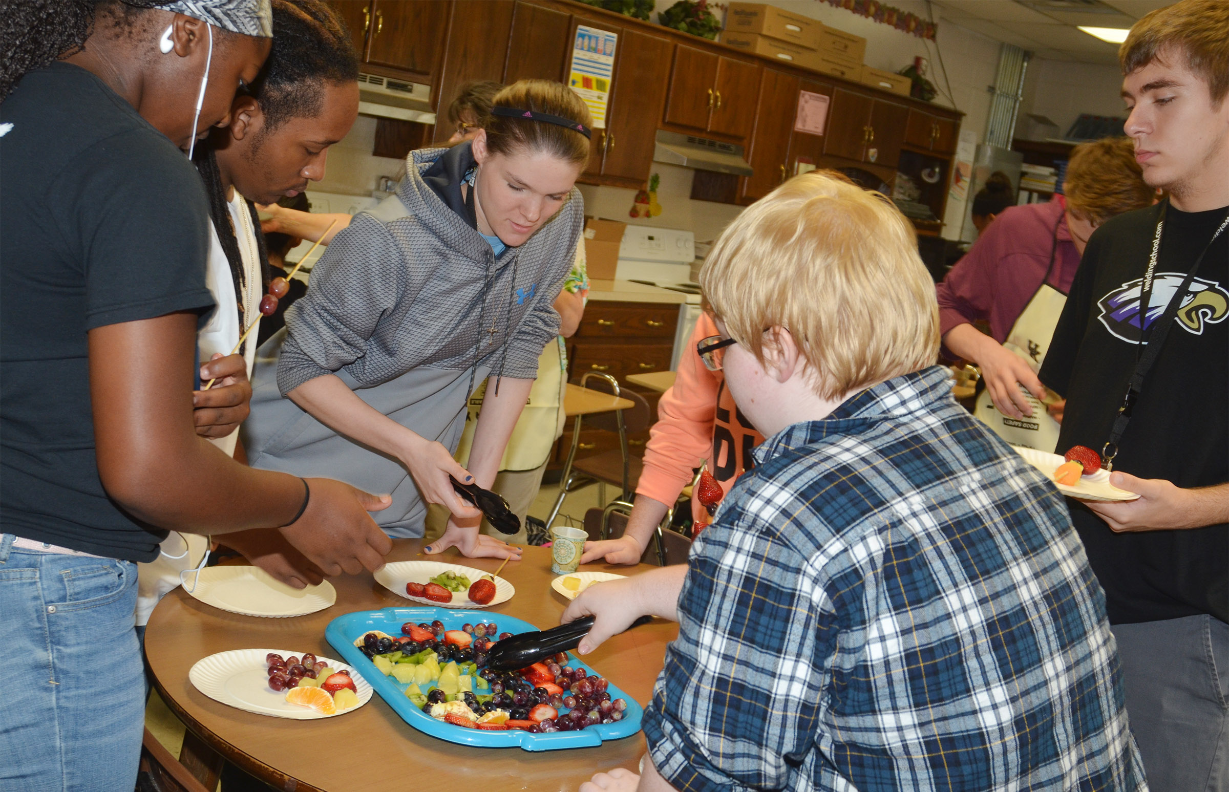 CHS students enjoy the fruit tray they made.