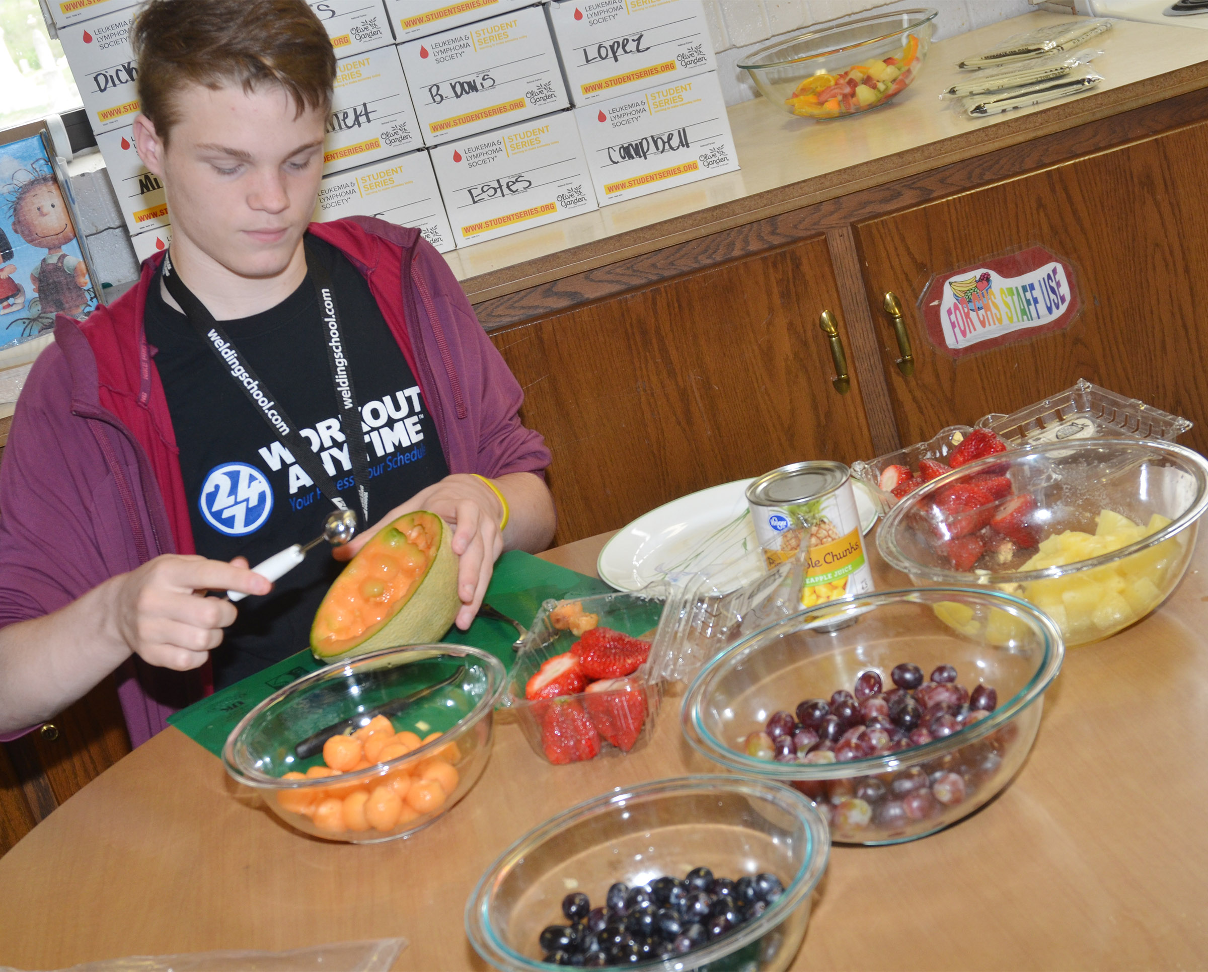 CHS sophomore Joe Pipes prepares ingredients for his classmates to make a fruit tray.