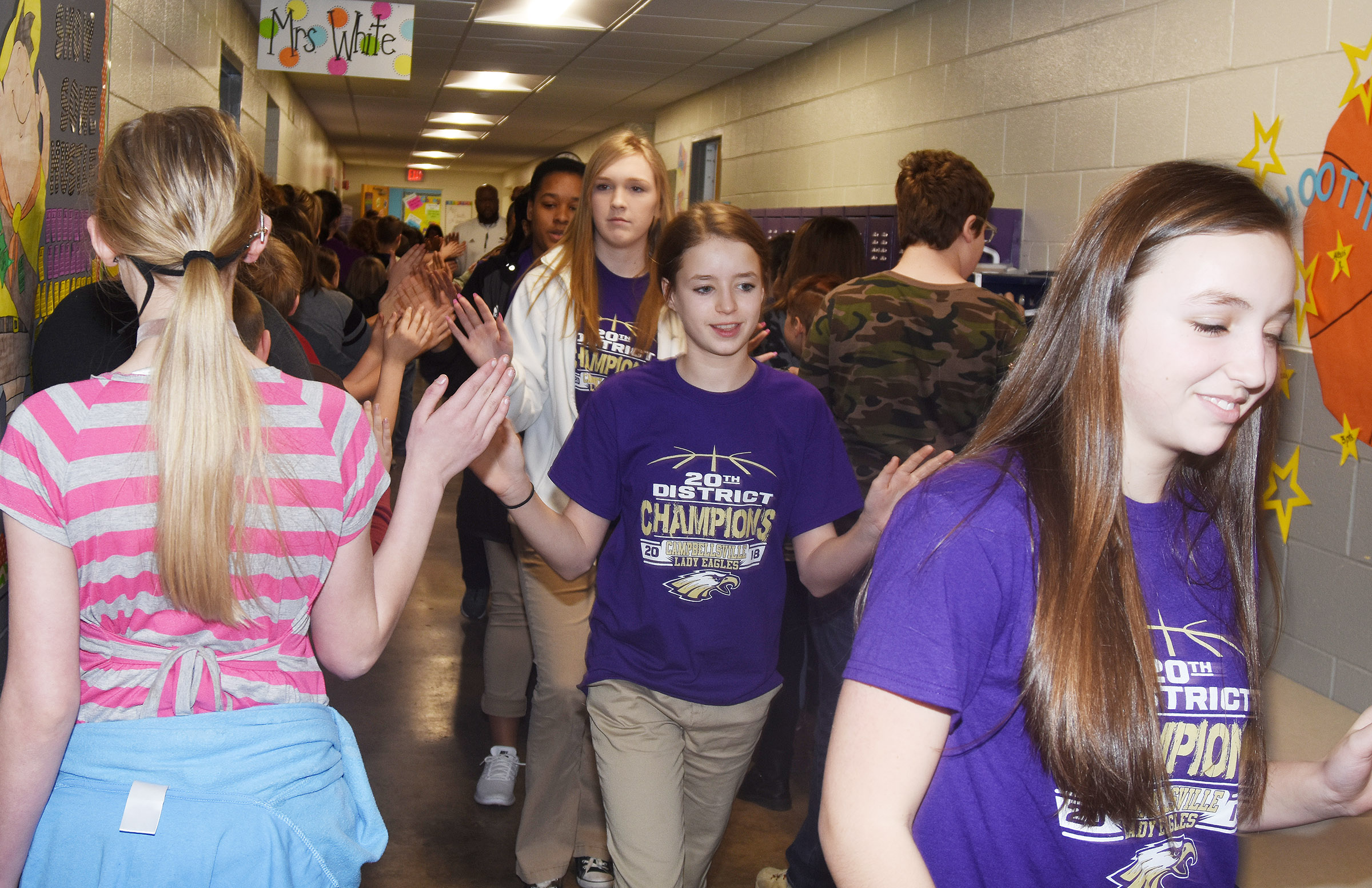 CHS girls' basketball player Lainey Watson, a Campbellsville Middle School eighth-grader, and her teammates high-five CES students.