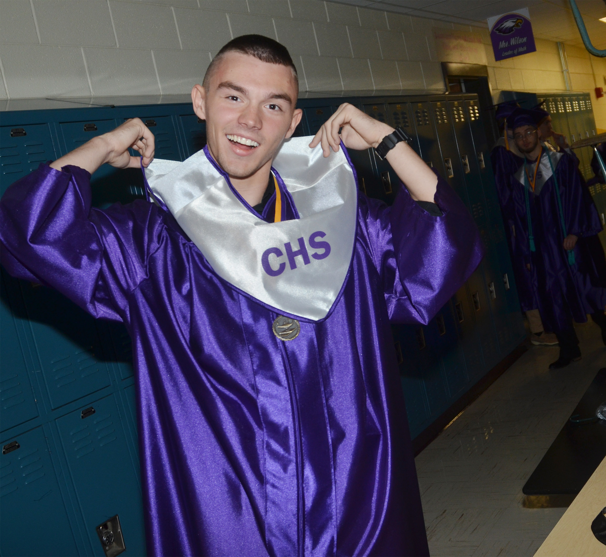 CHS senior Jordan Pratt adjusts his sash before graduation.