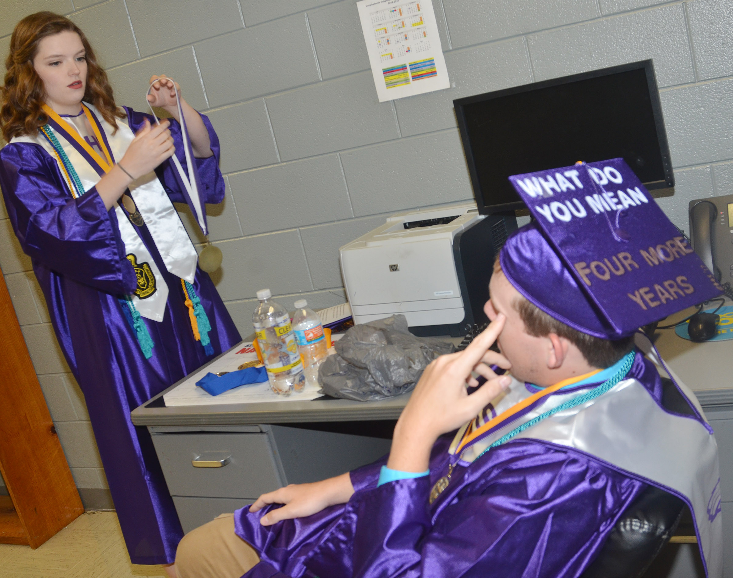 CHS seniors Blair Lamb, at left, and Jared Brewster get ready to graduate.