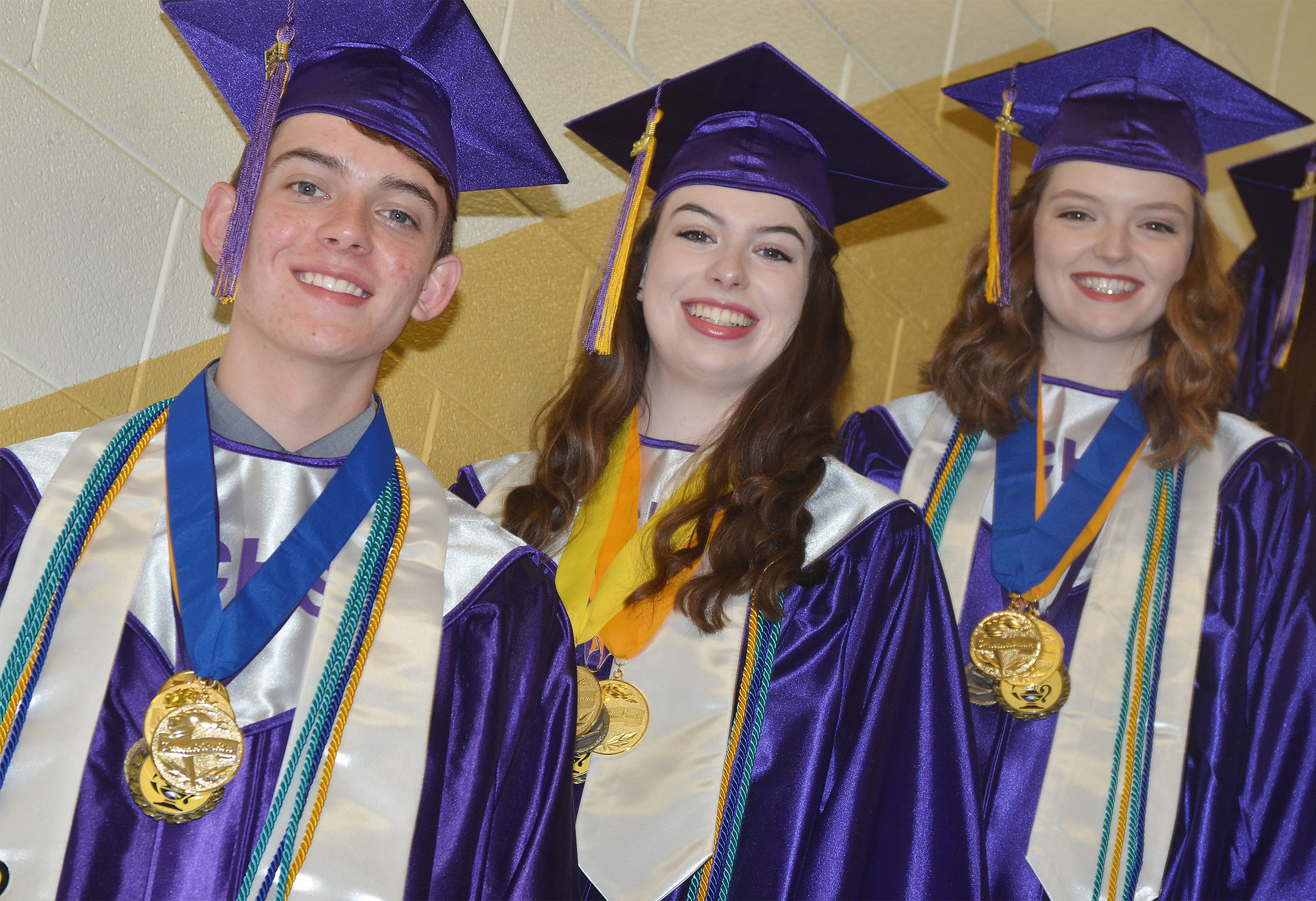 From left, CHS seniors Murphy Lamb, Laura Lamb and Blair Lamb smile before graduation.