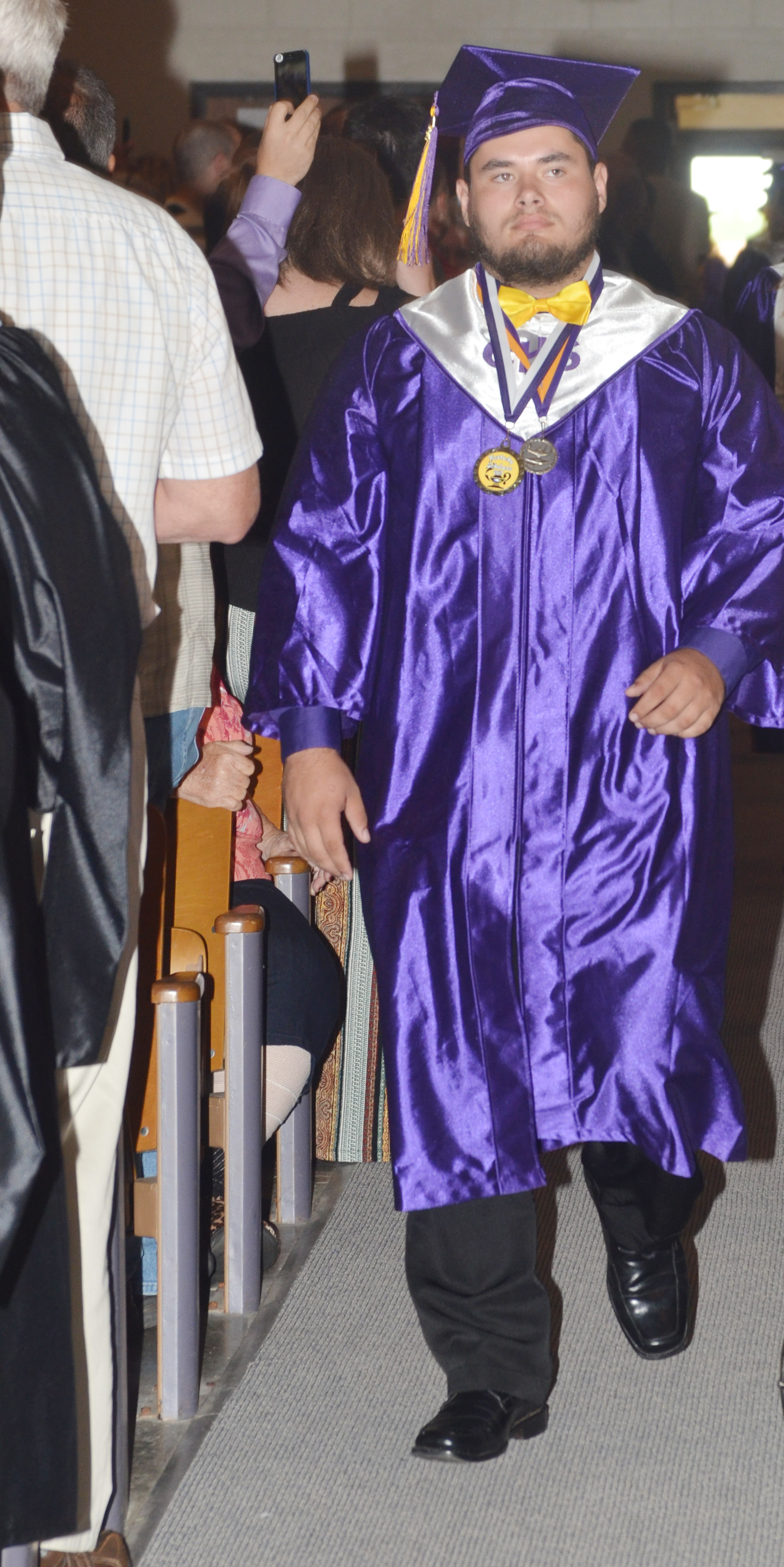 CHS senior Logan Brown walks to his seat.