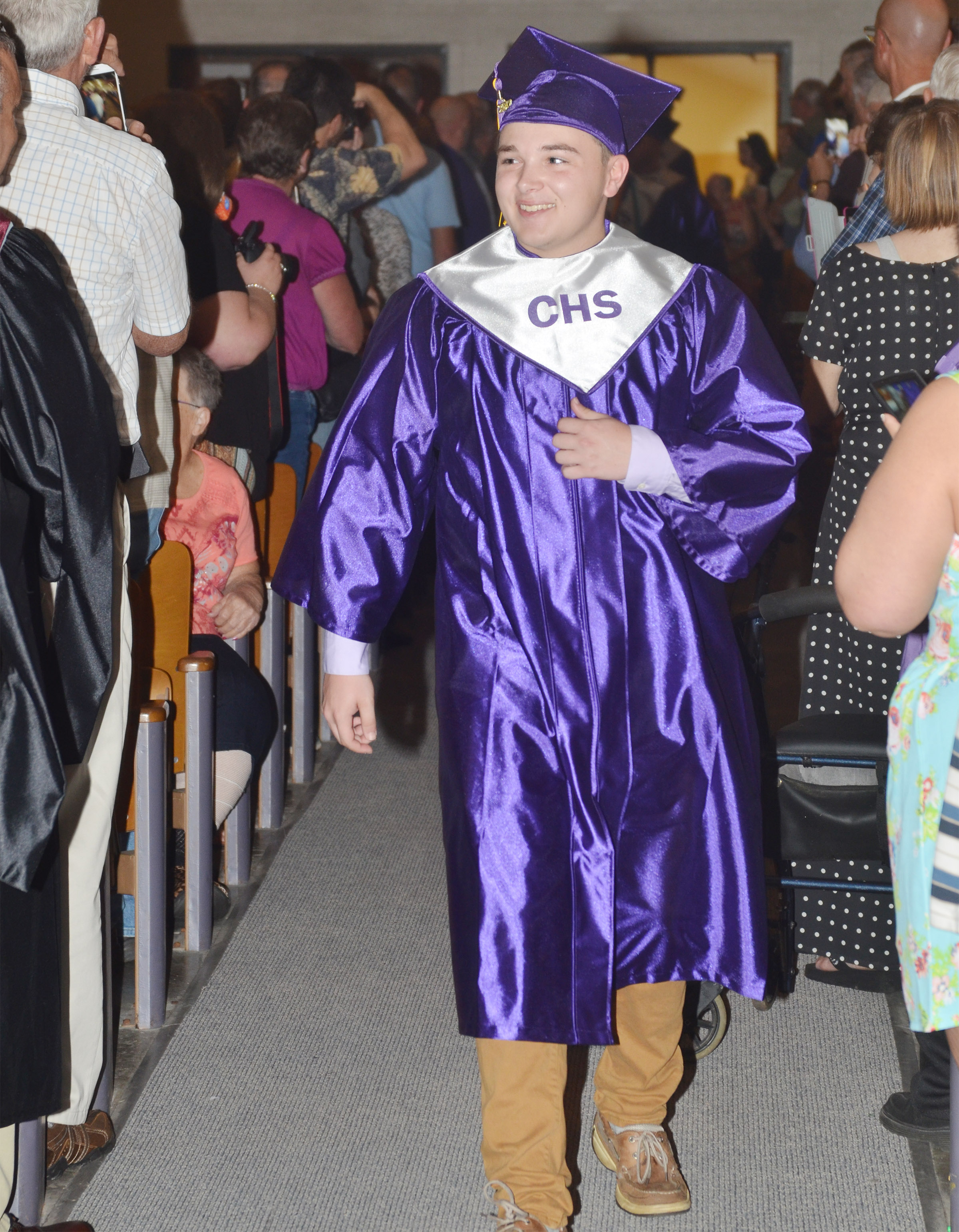 CHS senior Phoenix Burchett walks to his seat.