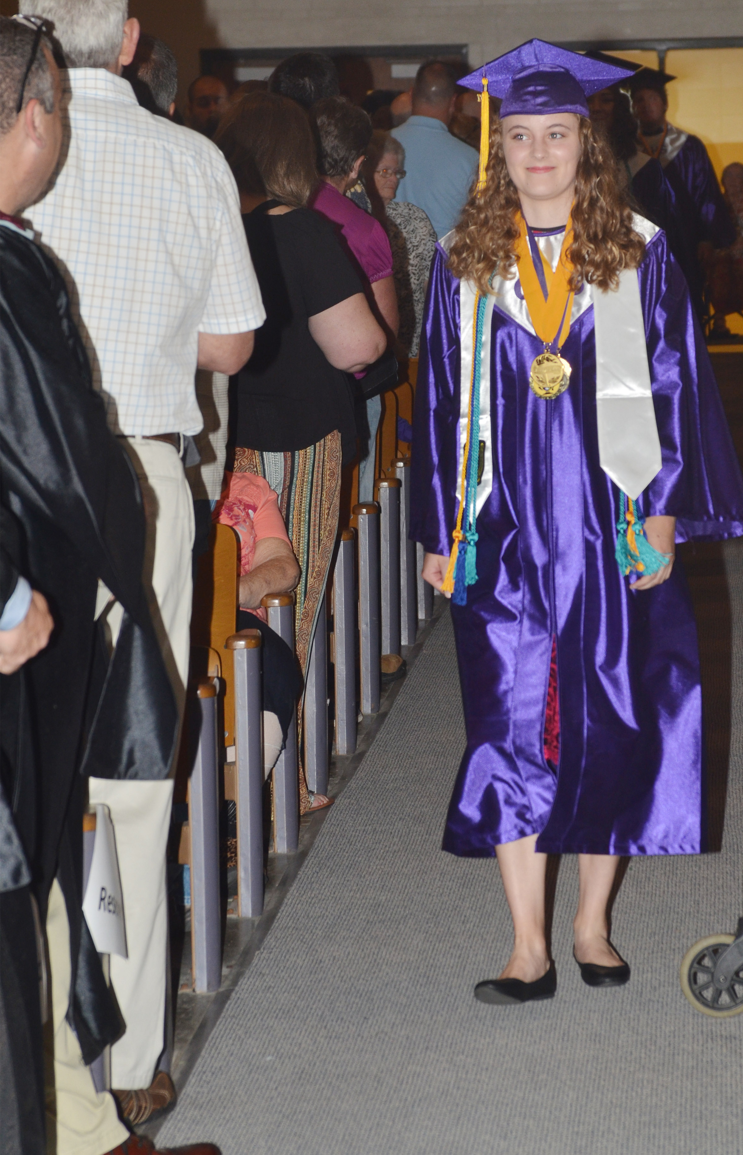 CHS senior Caroline McMahan walks to her seat.