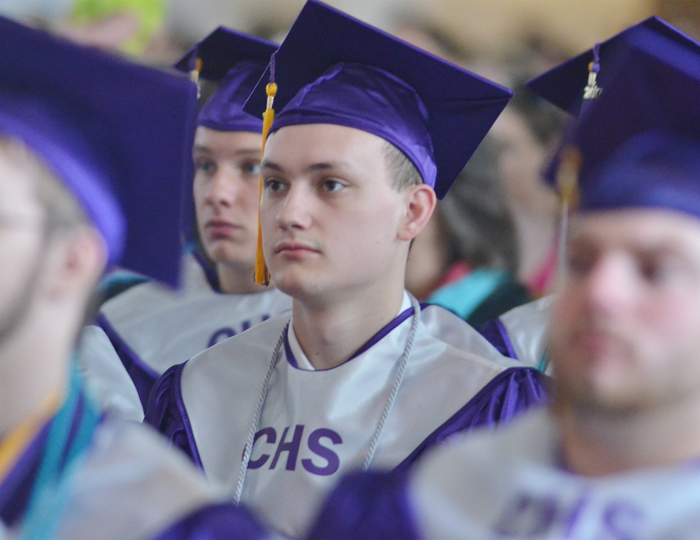 CHS senior Jonathan Rakes listens as Principal Kirby Smith speaks to his class.