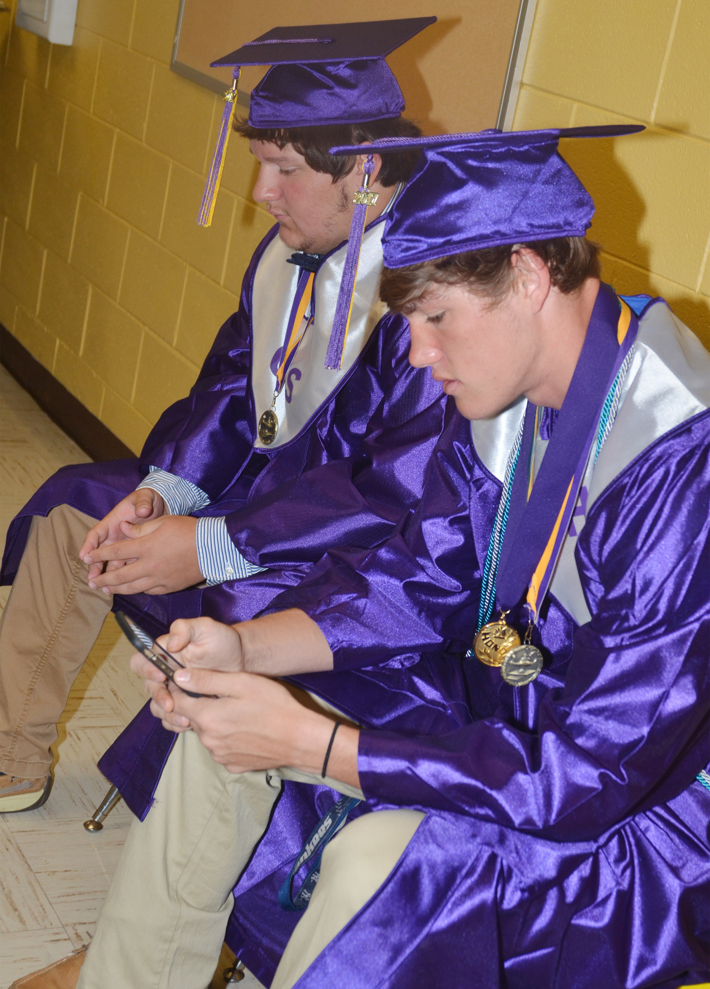 CHS seniors Donnie Osinger, at left, and Zack Bottoms talk before graduation.