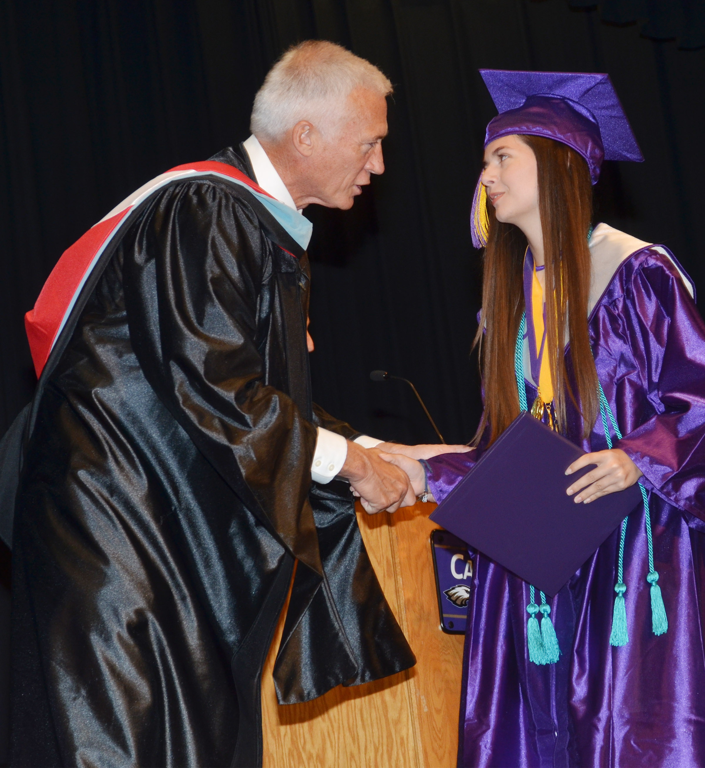 Campbellsville Independent Schools Superintendent Mike Deaton congratulates Shauna Jones.