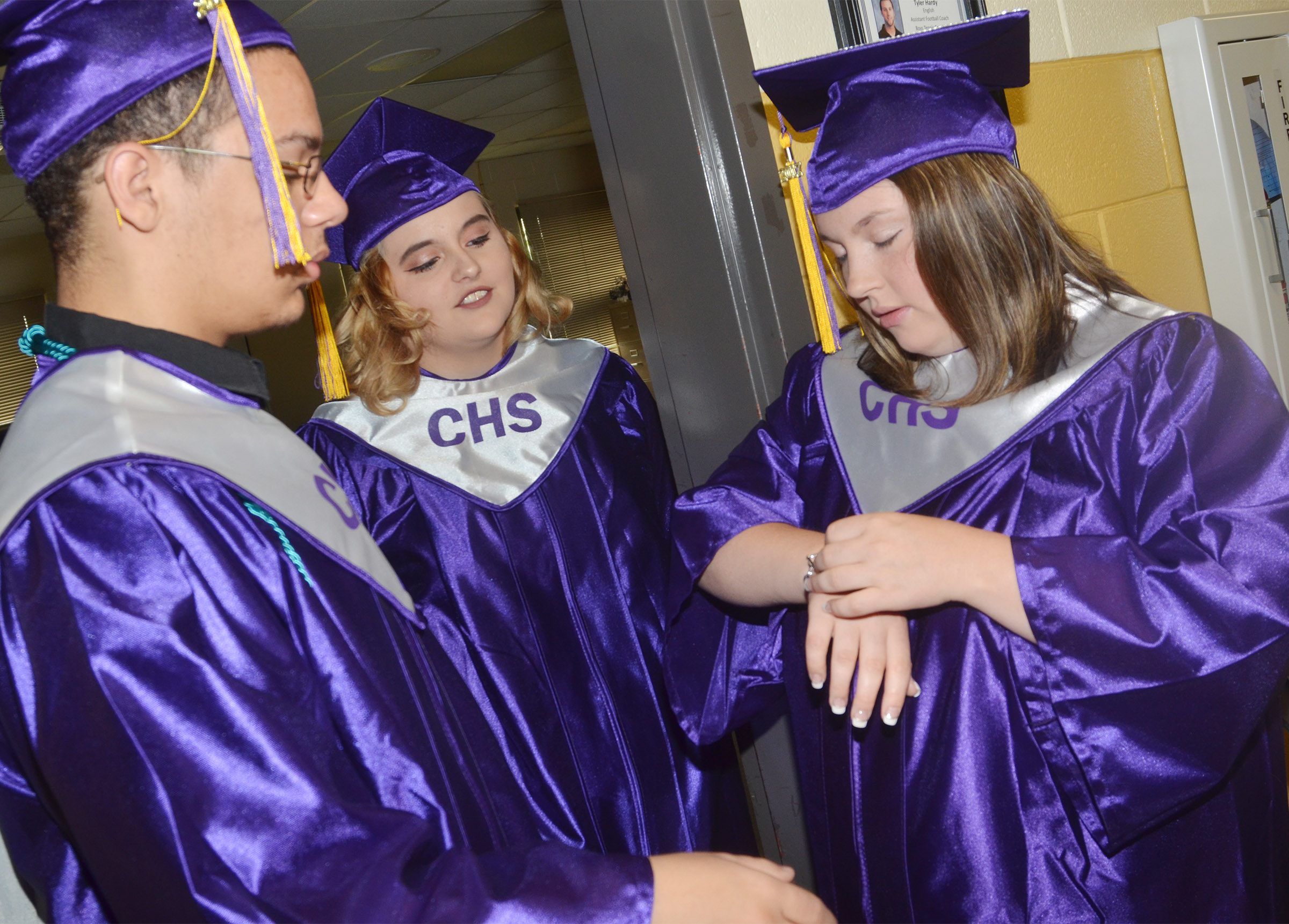 From left, CHS seniors Michael Porter, Cassie Pendleton and Shelby Page talk before graduation.