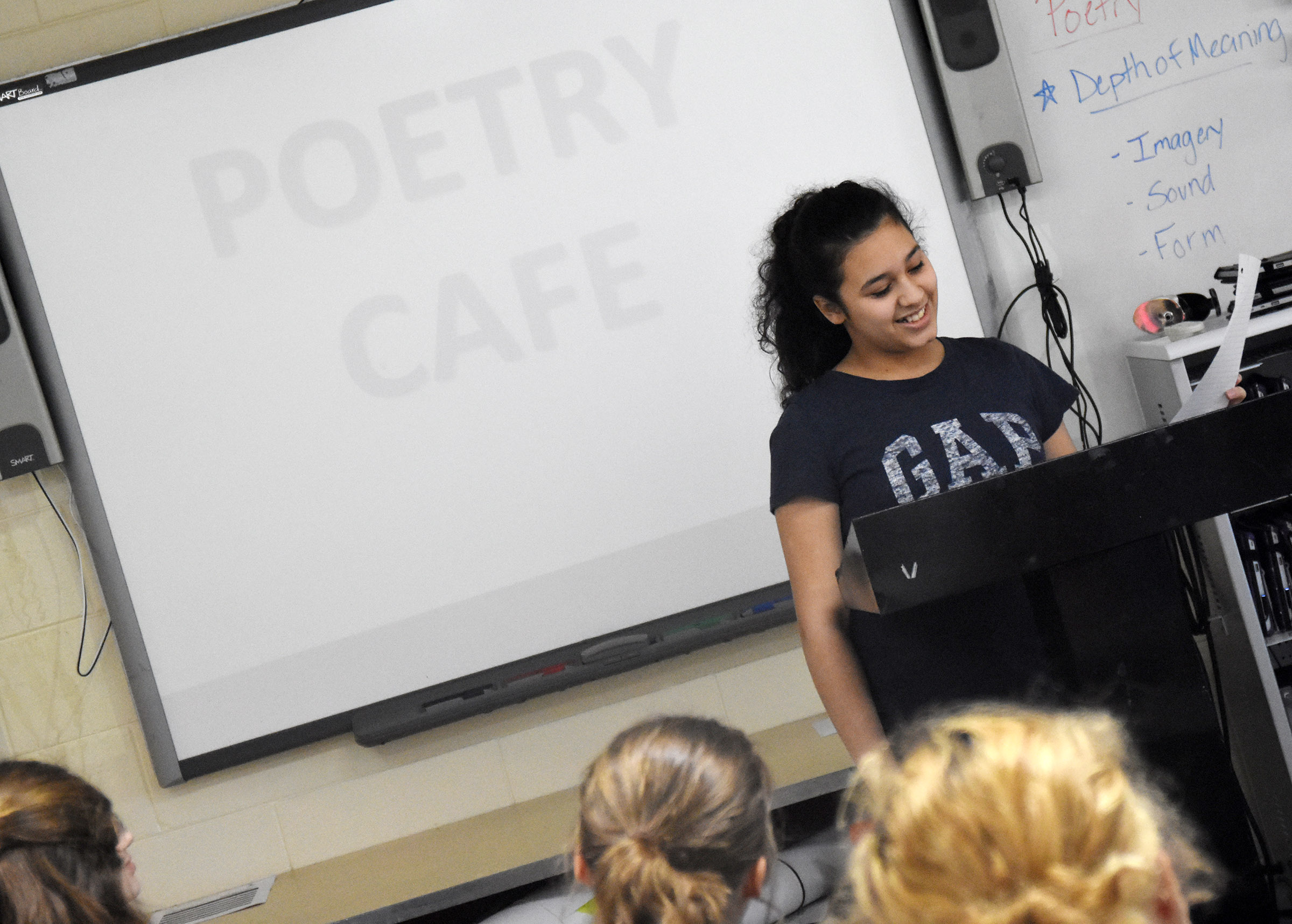 Campbellsville Middle School eighth-grader Bia Moura reads her poetry.