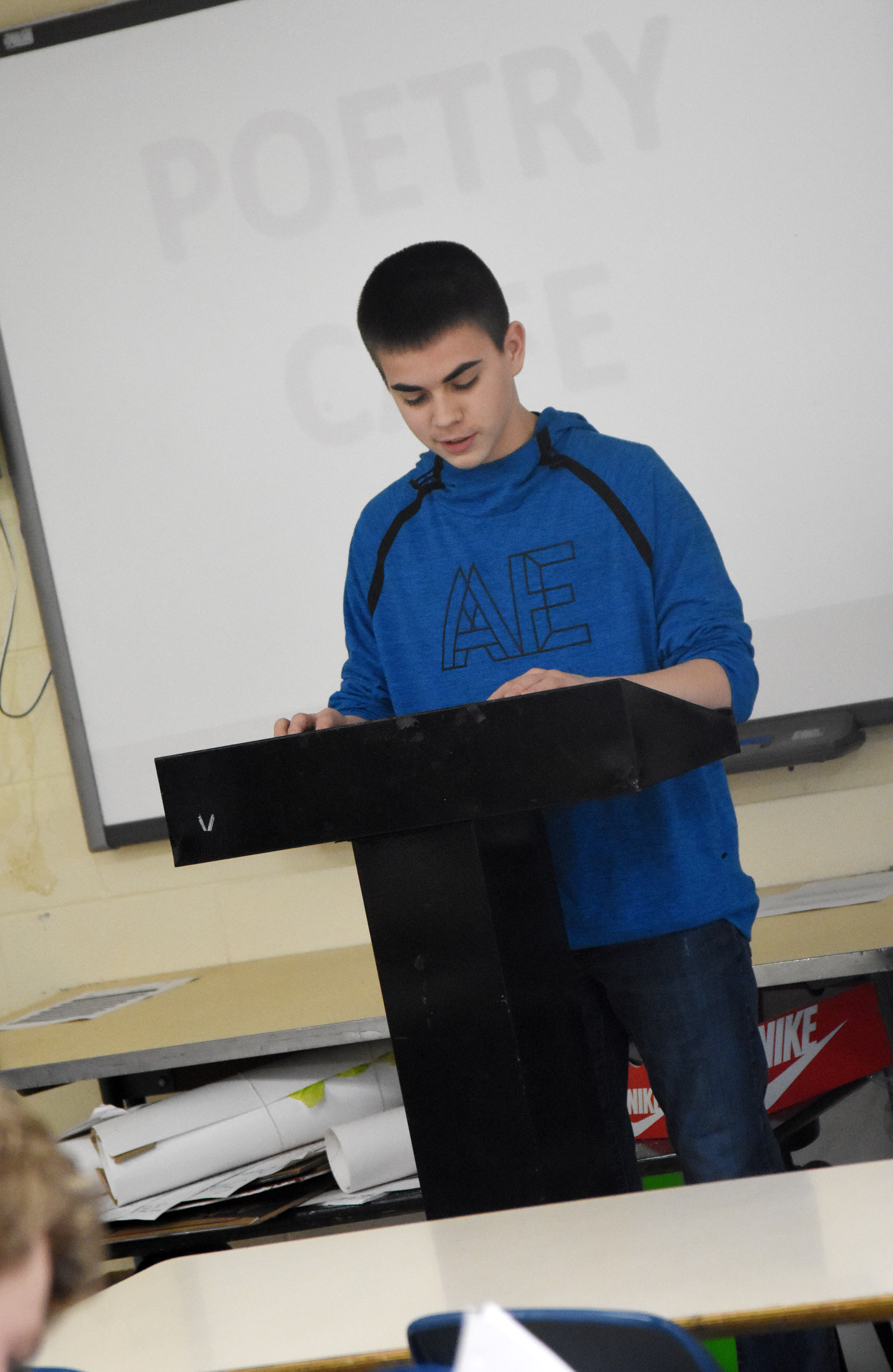 Campbellsville High School freshman Clark Kidwell reads his poetry.