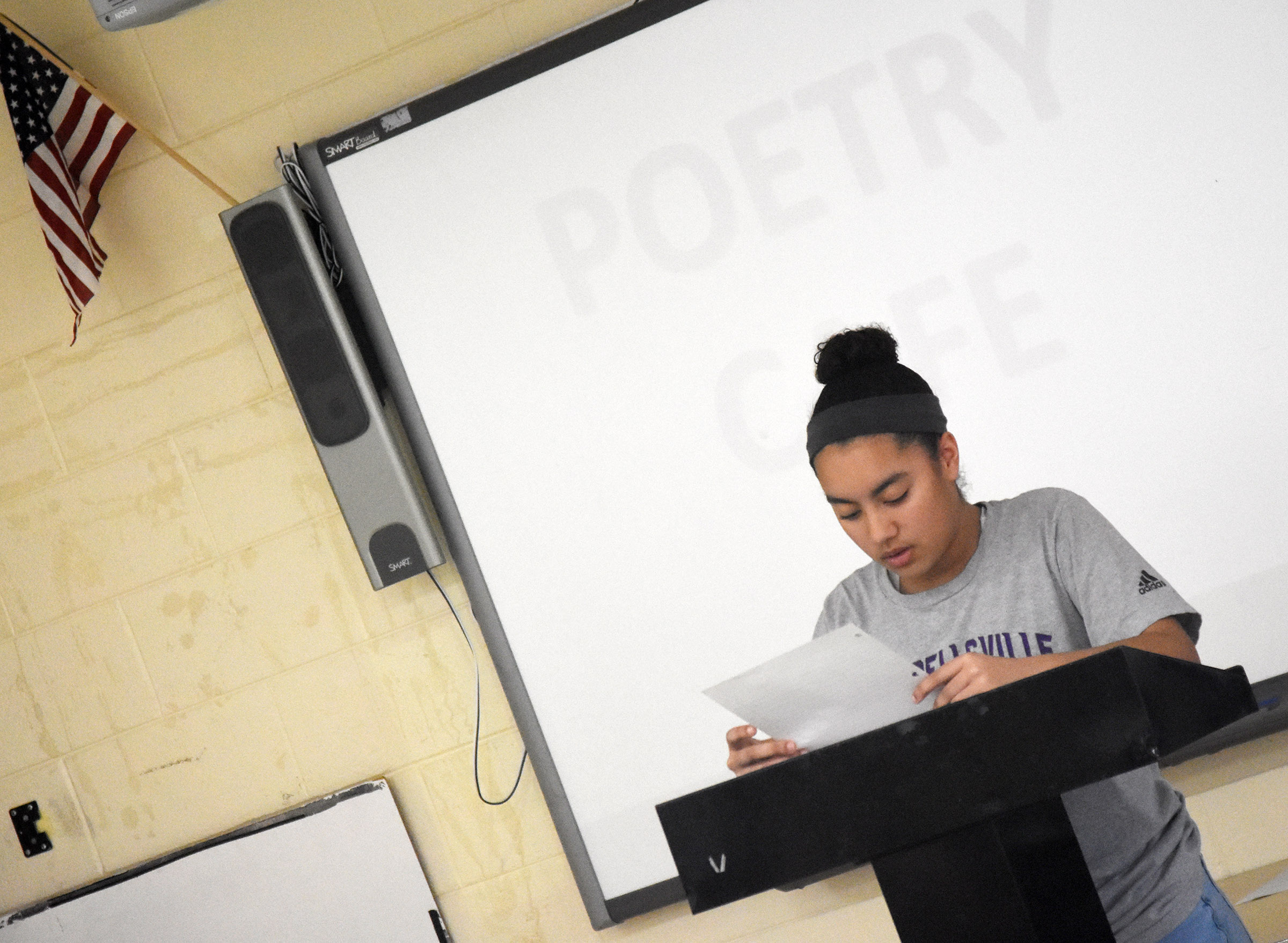 Campbellsville High School freshman Laci Hodgens reads her poetry.