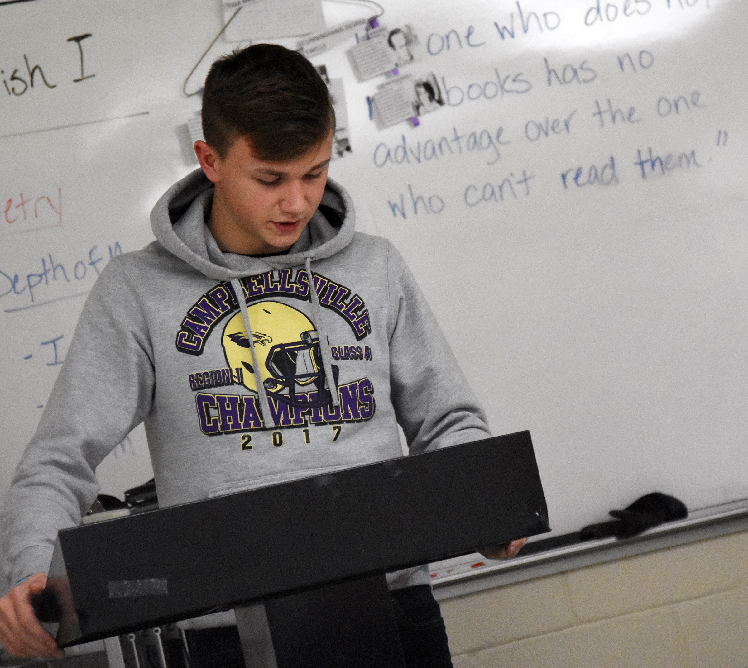 Campbellsville High School freshman Blase Wheatley reads his poetry.