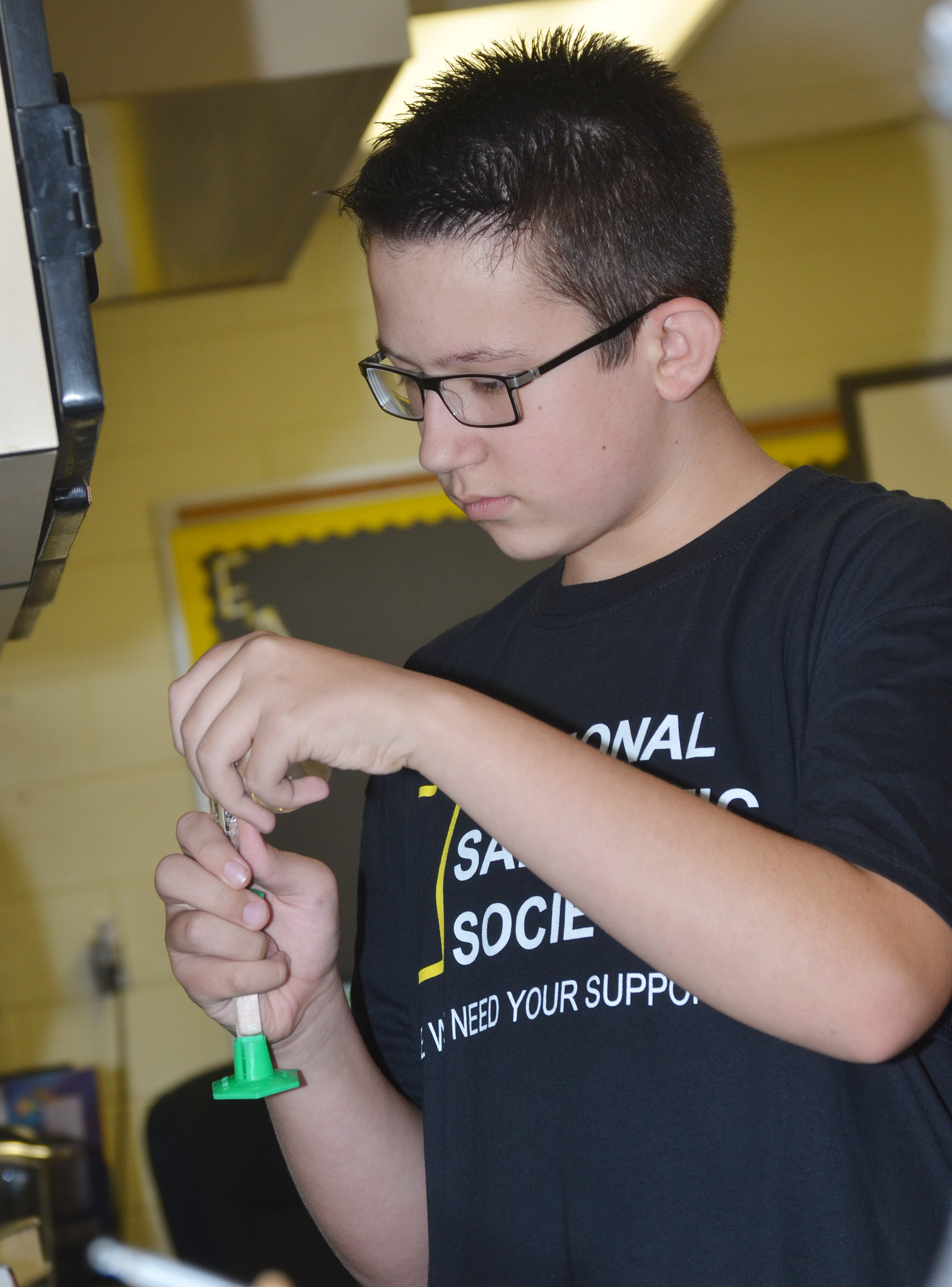 CHS freshman Nathan Sowders measures water.
