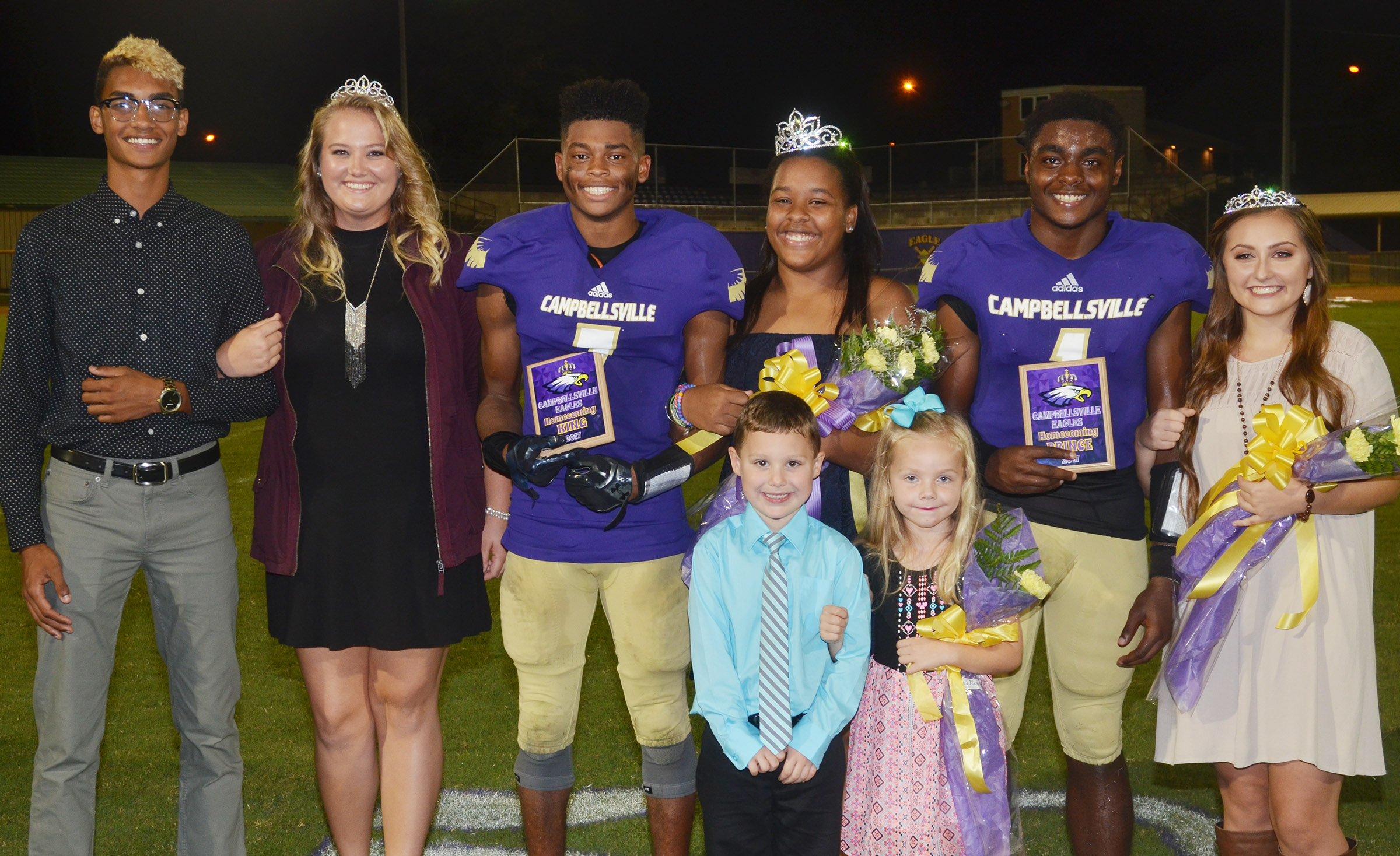 This year's CHS homecoming king and queen are seniors Devonte Cubit and Kayla Young, center. At right are prince and princess Charlie Pettigrew and Reagan Knight, representing the junior class. In front are Campbellsville Elementary School kindergarteners Kyler Wilson and Trinidy Gribbins, who were the crown bearers. And at left are Daniel Silva and Brenna Wethington, who graduated from CHS in May and were last year's football homecoming king and queen.