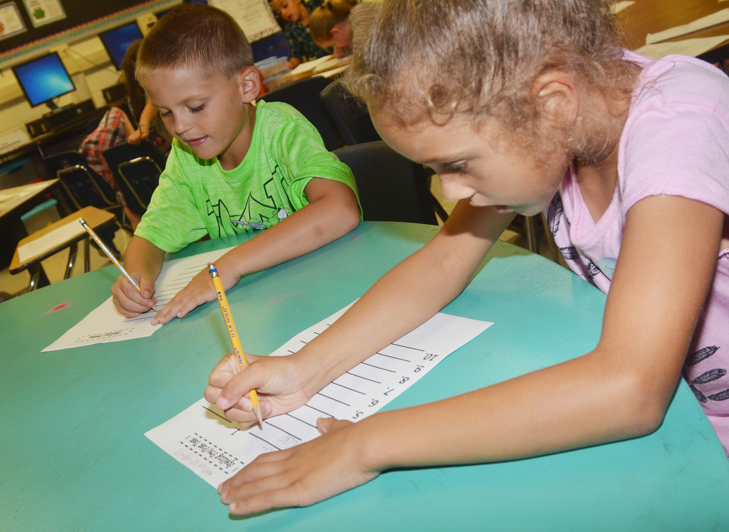 CES second-graders Seeley Whitaker, at left, and Keiava Thompson spell a sight word on their pre-test.