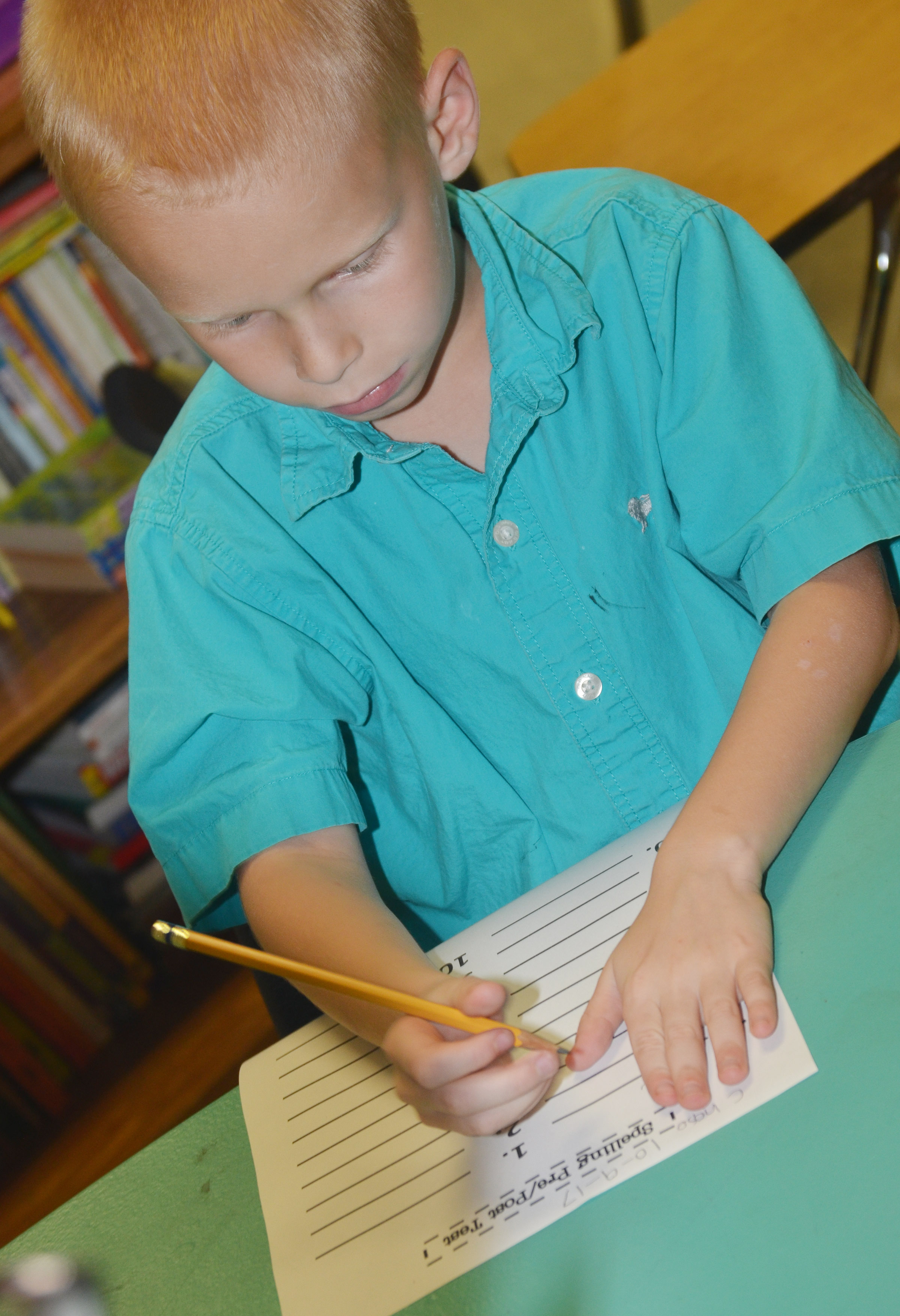 CES second-grader Chase Gabbert spells a word on his pre-test.