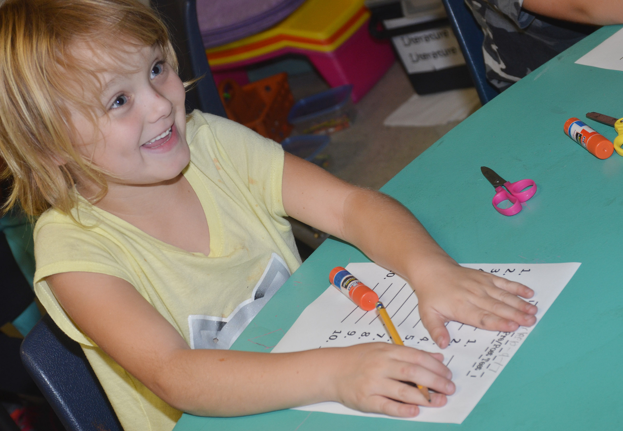 CES second-grader Mylee Bell smiles as she spells a word on her pre-test.