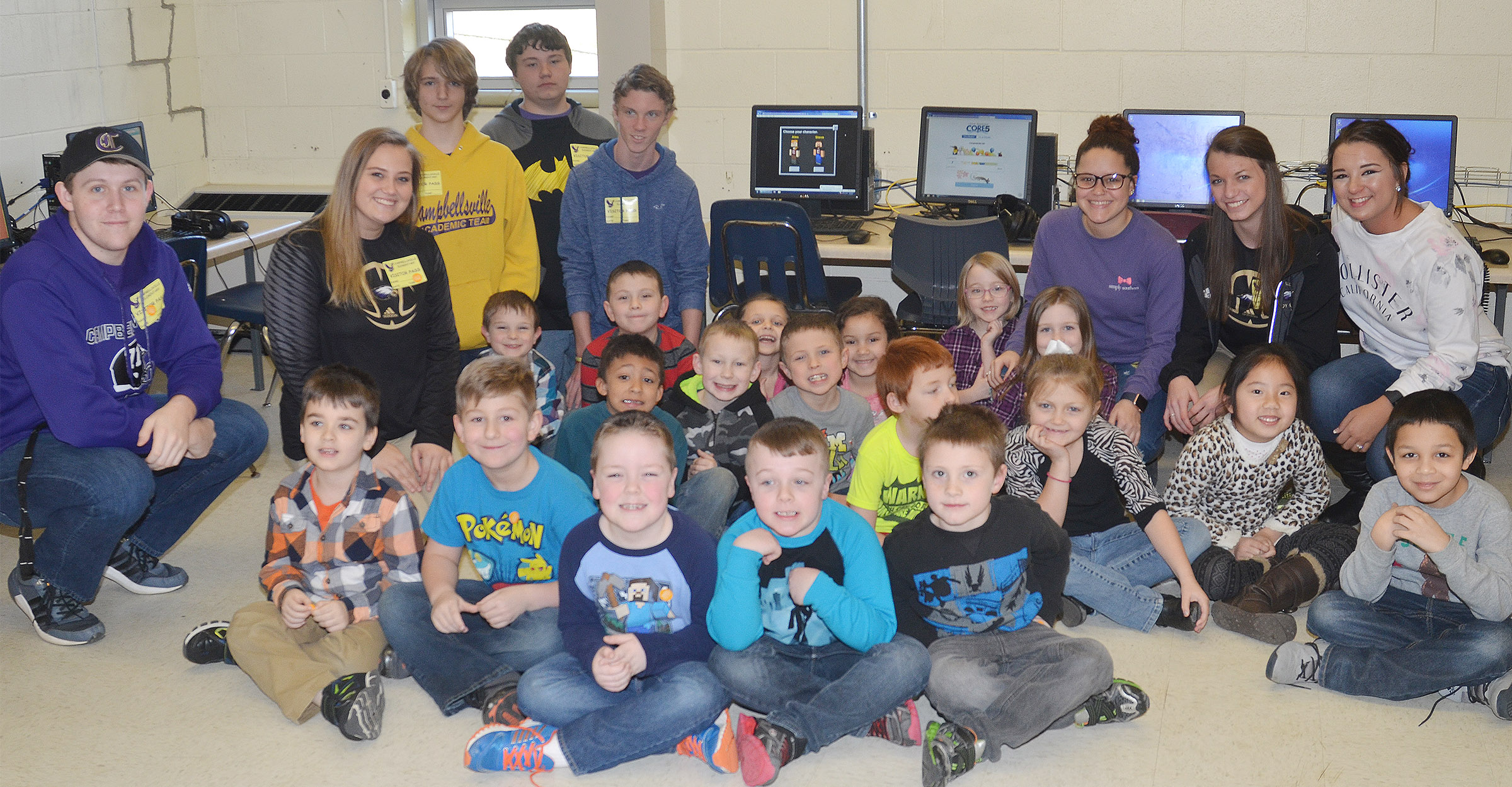 CHS computer science students taught Amanda Greer's first-grade students about computer coding. From left, in back, are seniors Jared Brewster and Brenna Wethington, freshmen Tristin Lopez and Conner Riley, sophomore Payton Reynolds and seniors Breanna Spaulding, Caylie Blair and Kailey Morris.