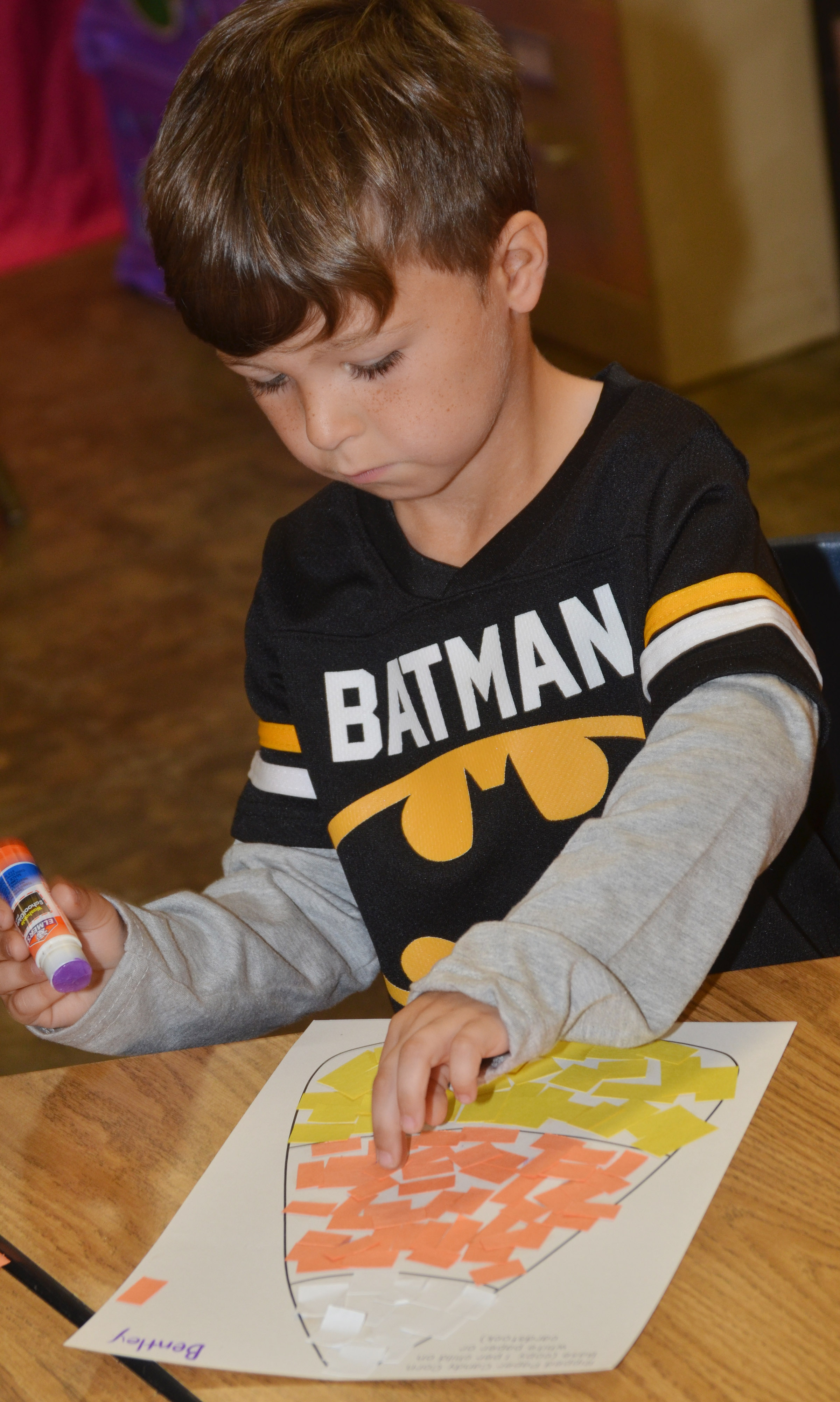 CES kindergartener Bentley Wilhoite glues construction paper on his candy corn.