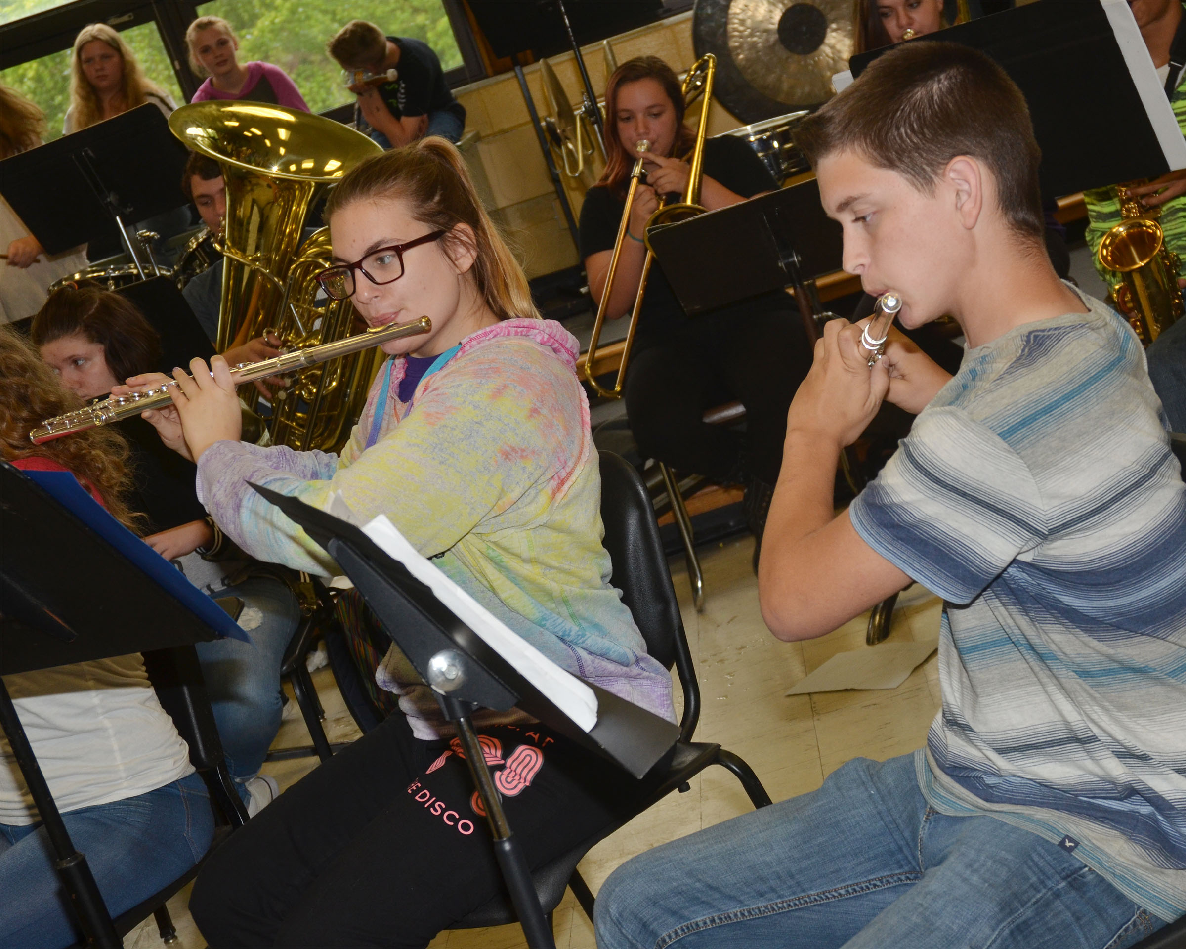 CHS senior Tiffany Kane, at left, and Campbellsville Middle School seventh-grader Caden Cowherd play flute.