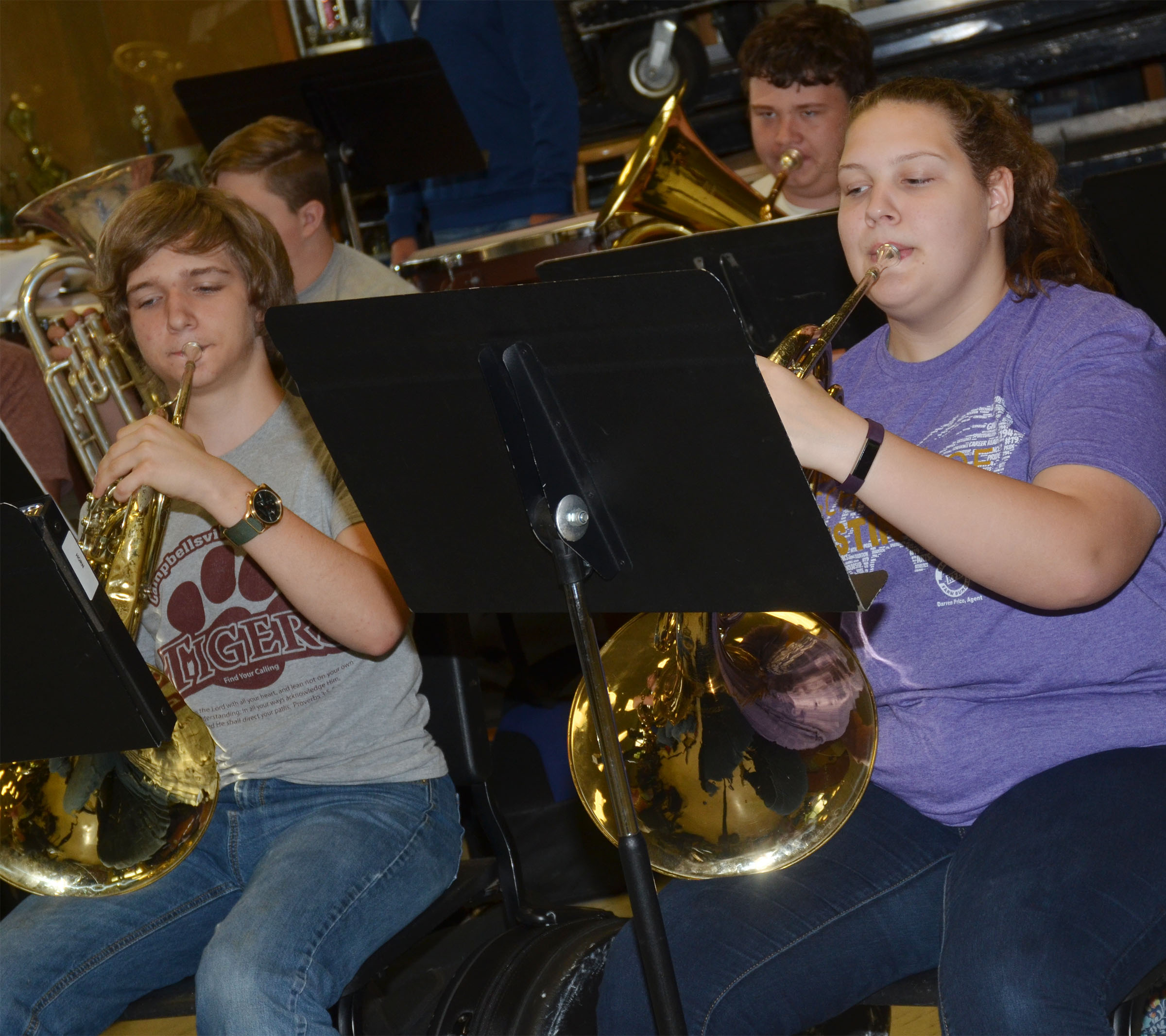 CHS freshman Tristin Lopez, at left, and Abie Angel play French horn.