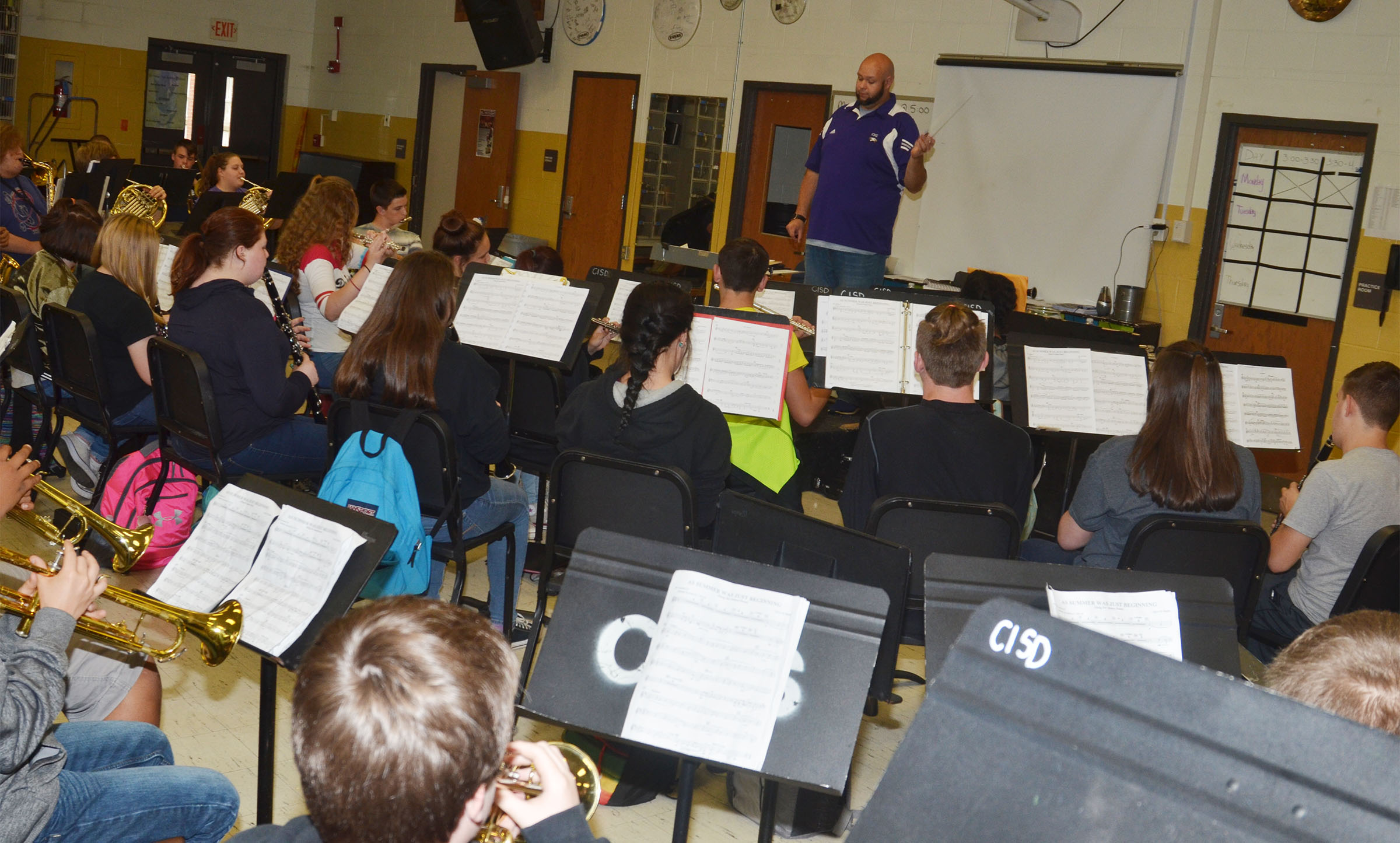 "CHS Band Director Zach Shelton leads his band as members perform ""As Summer Was Just Beginning."""