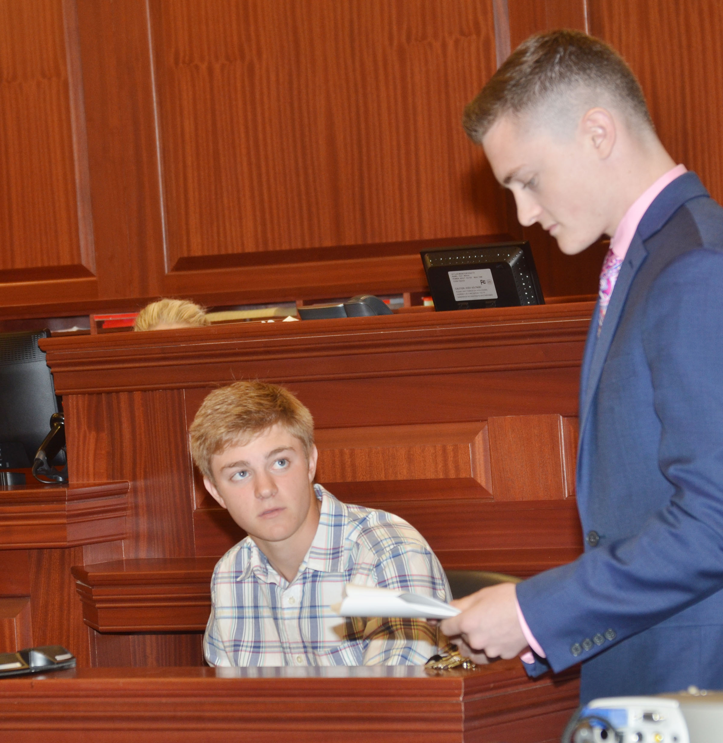 CHS junior Alex Doss portrays a defendant as prosecutor Bryce Richardson questions him.