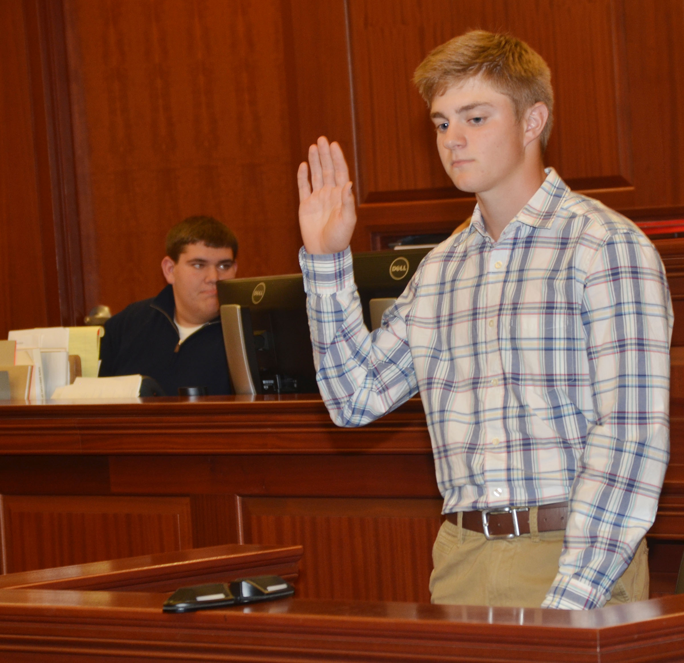 CHS junior Alex Doss is sworn in as he testifies on his own behalf during the mock trial.