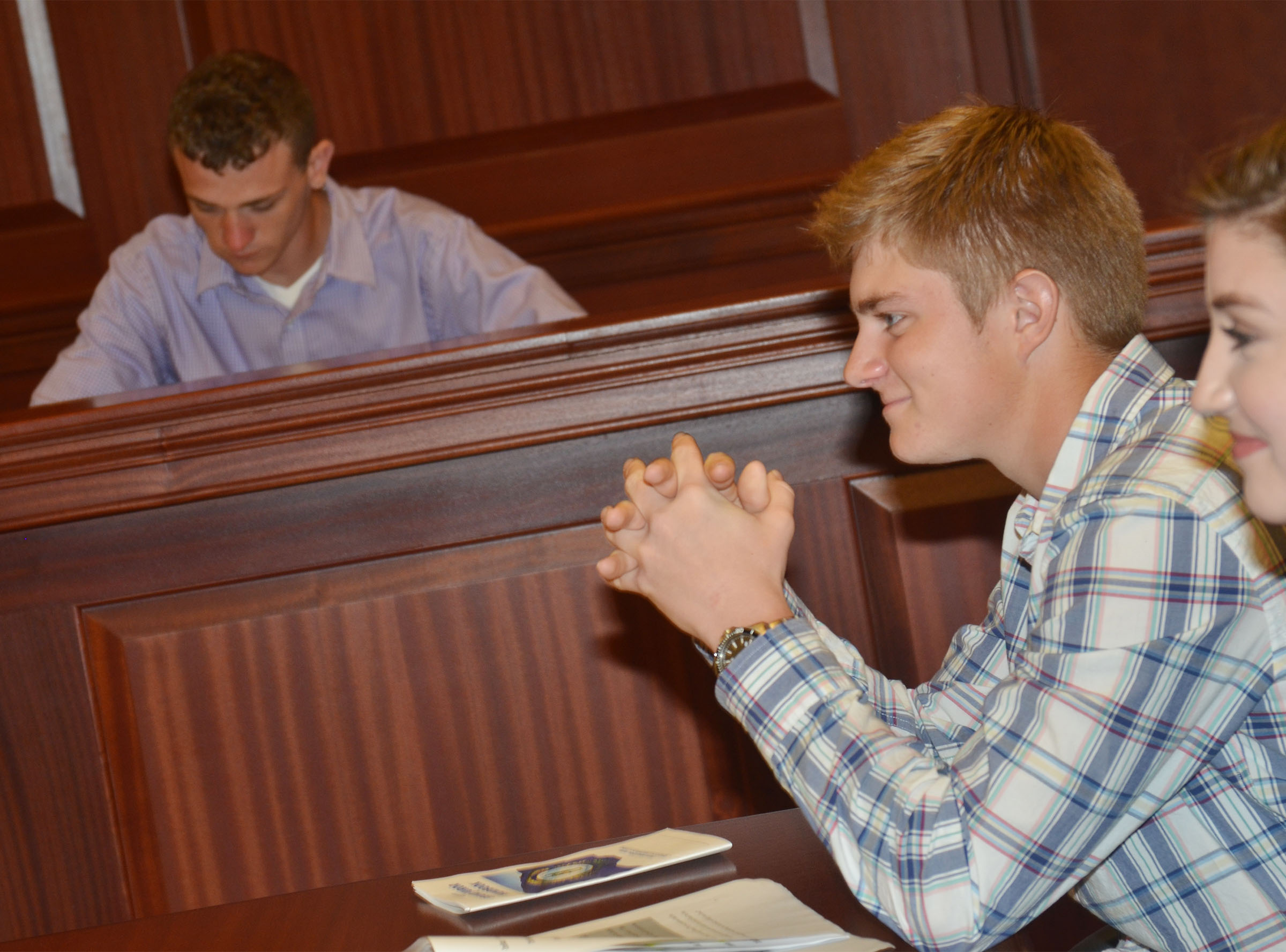 CHS junior Alex Doss listens to witness testimony as he portrays the defendant in the mock trial.
