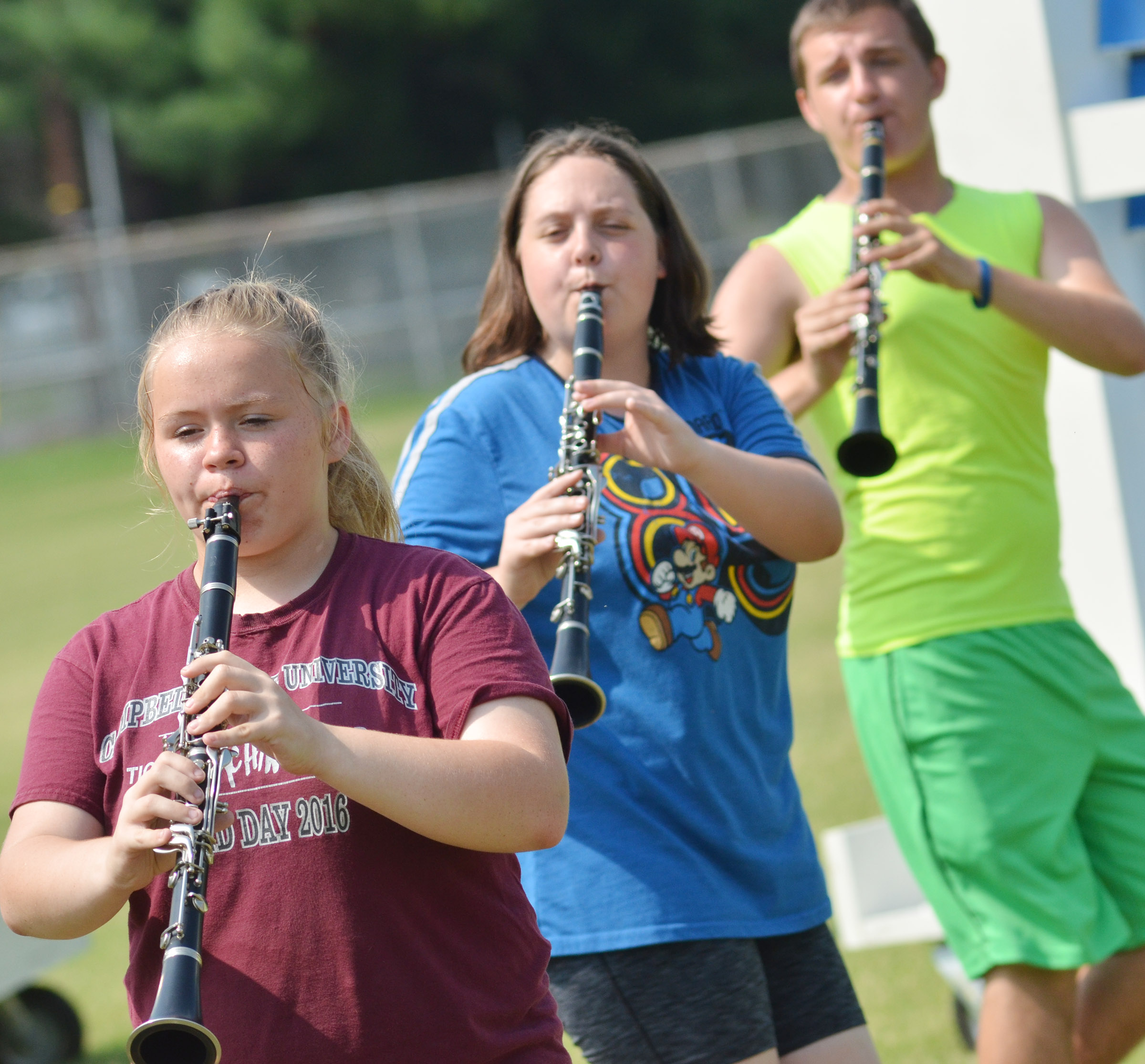 From left, Campbellsville Middle School eighth-grader Riley Rainwater, CHS junior Ruby Hatfield and senior Austin Fitzgerald play clarinet.