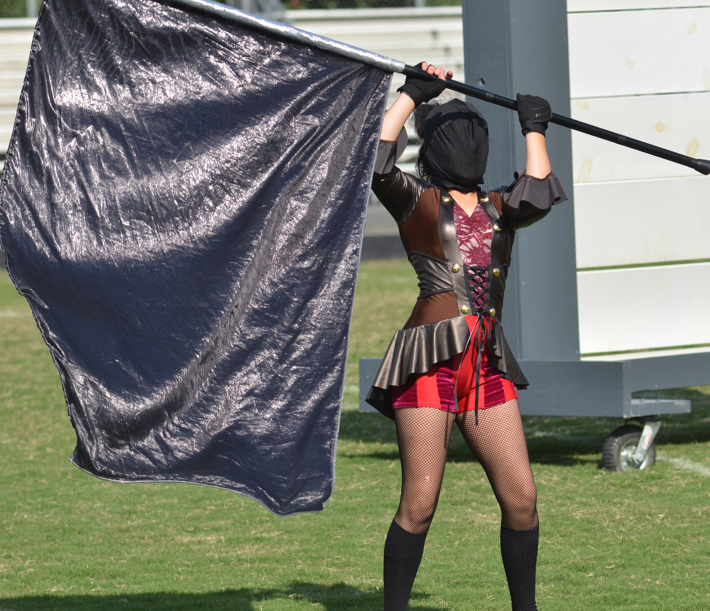 Campbellsville Middle School seventh-grader Alyssa Orberson performs with the color guard.