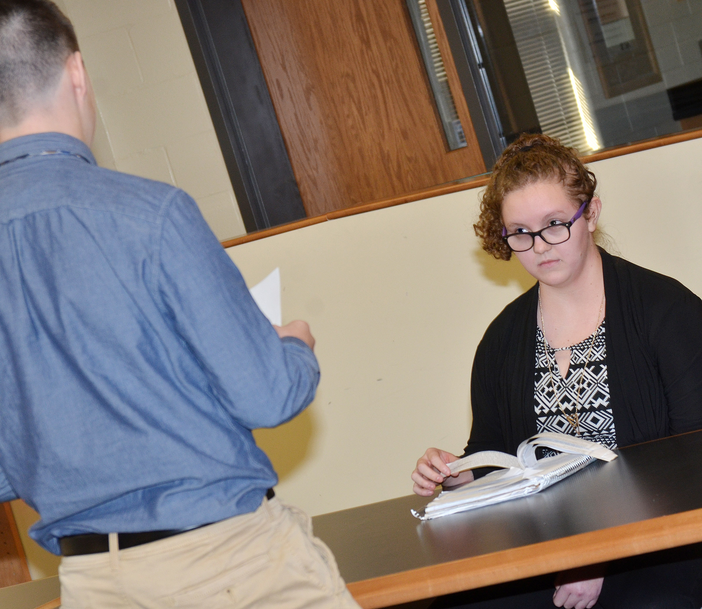 CHS sophomore Cole Kidwell, portraying a prosecutor, questions Emily Rodgers, a sophomore, who portrays a witness.