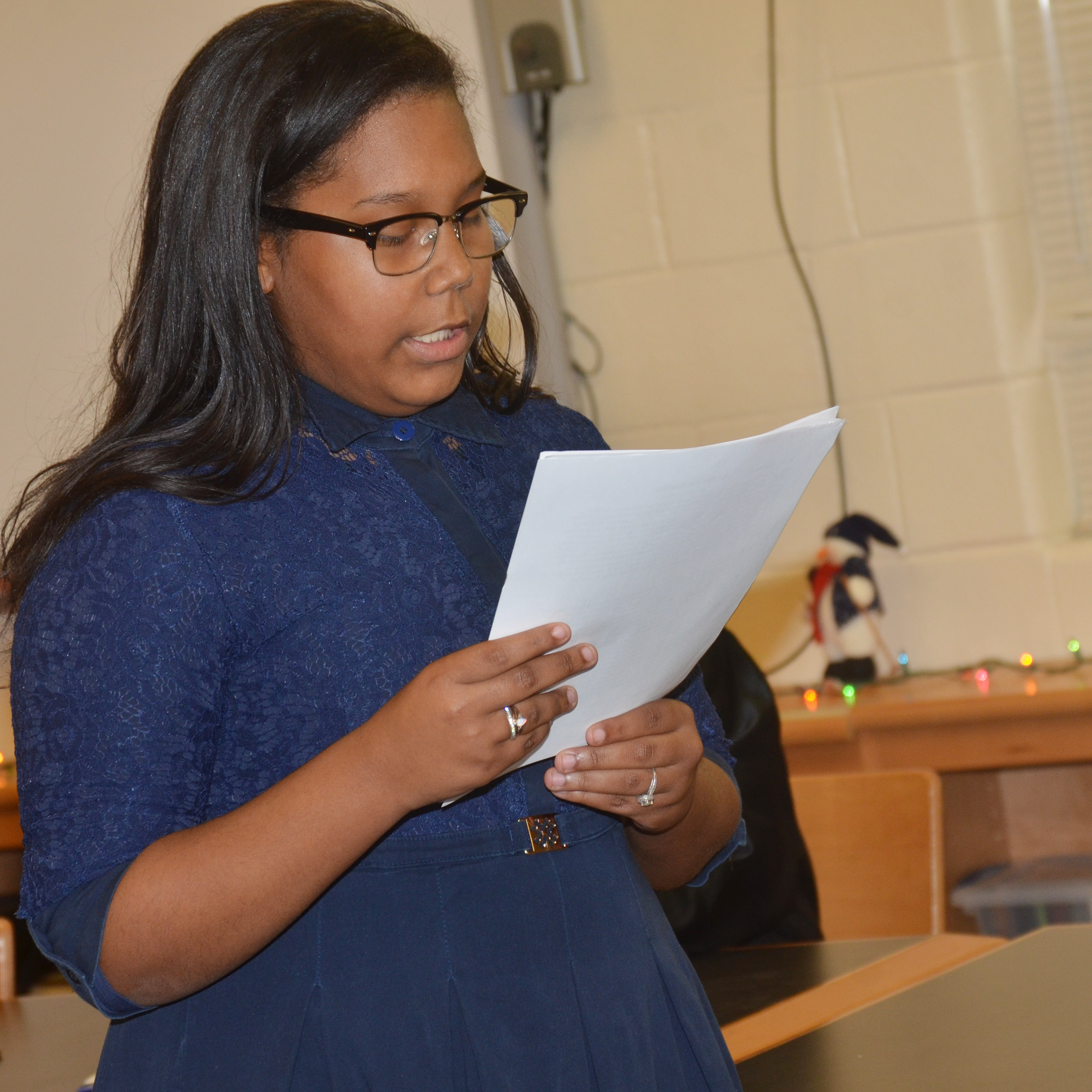CHS sophomore Zaria Cowan, portraying a defense attorney, questions a witness.