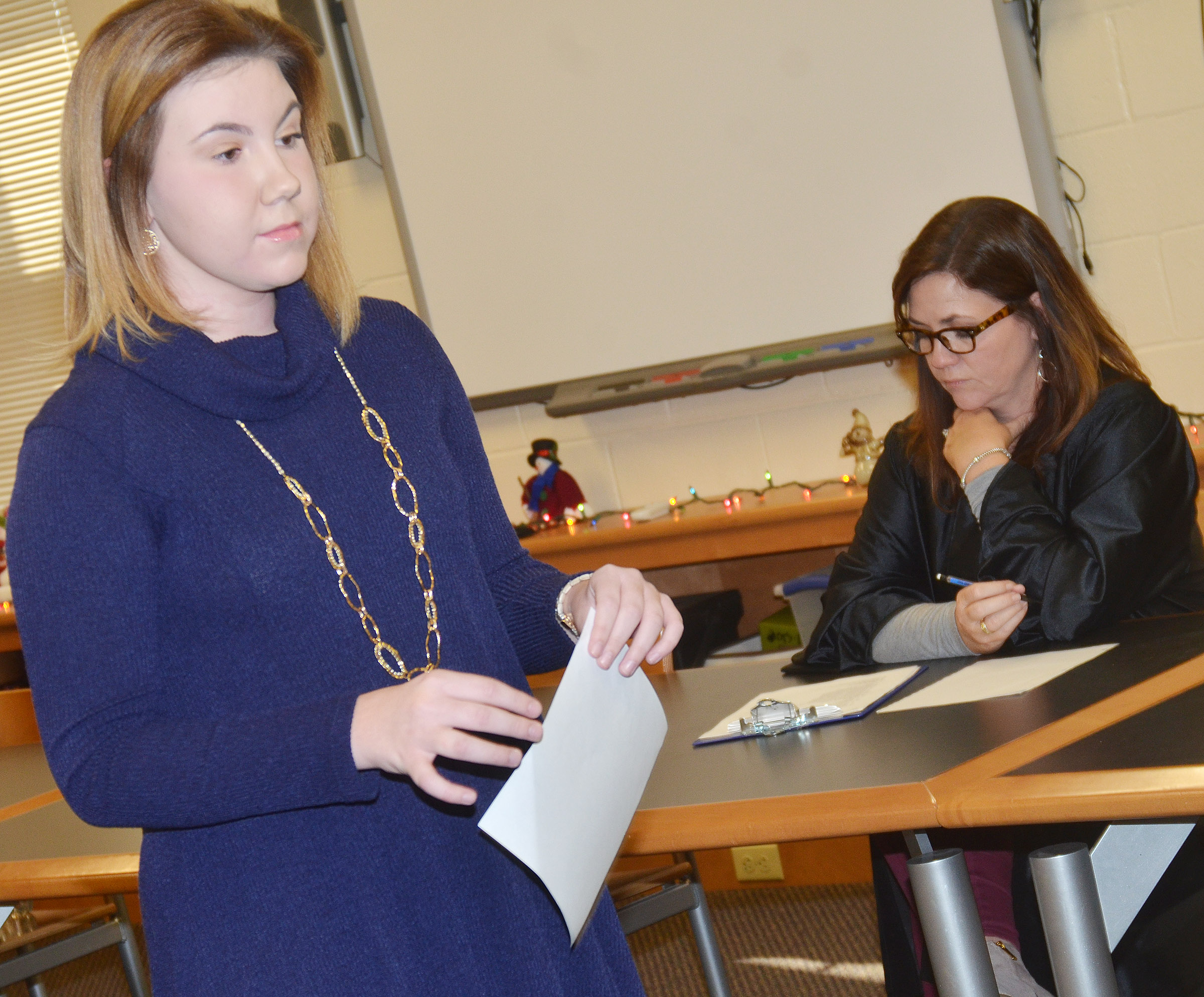 CHS sophomore Lauryn Agathen asks questions as a prosecutor, as teacher Susan Dabney listens while portraying a judge.