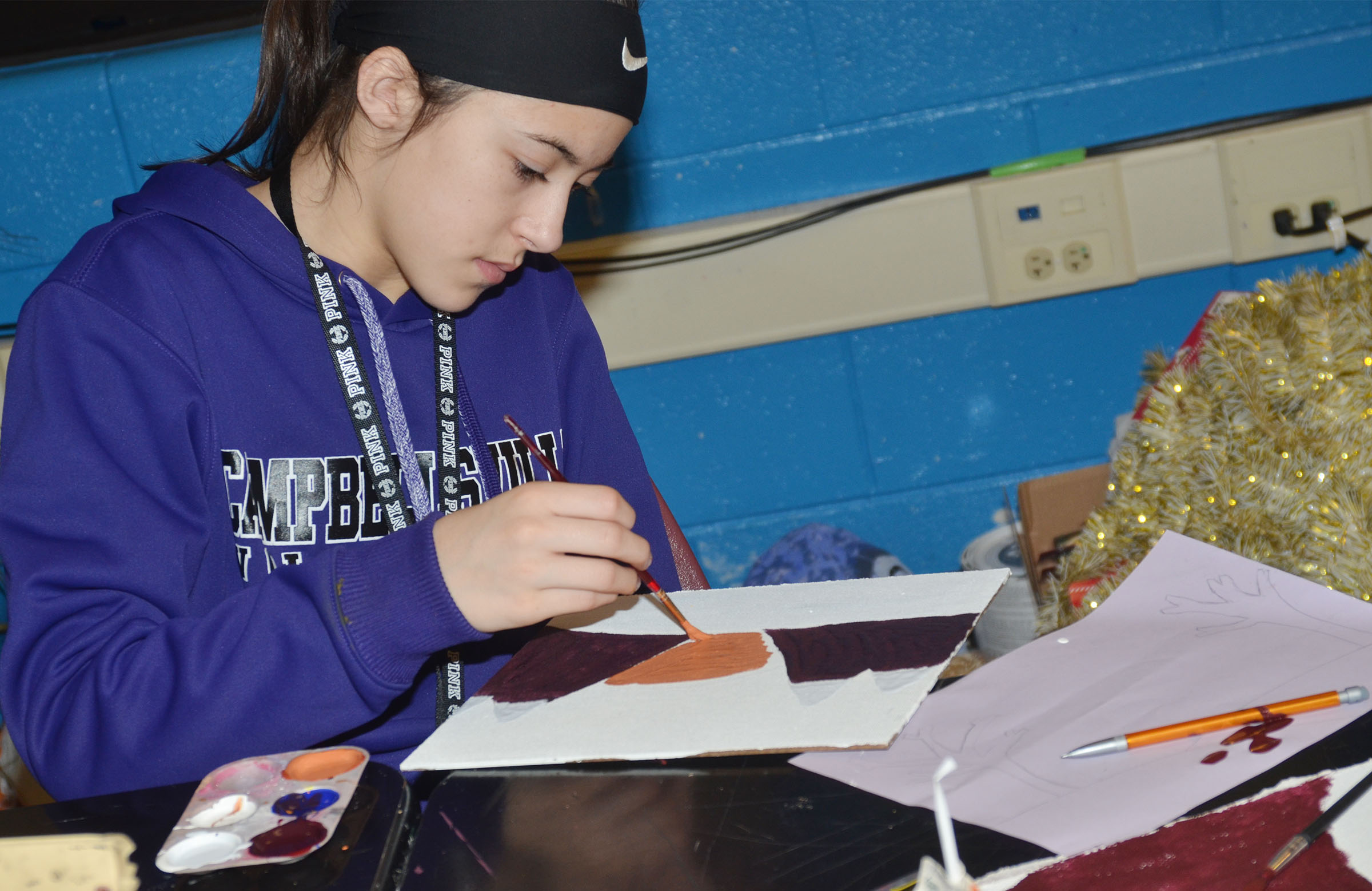 Campbellsville Middle School seventh-grader Kaylyn Smith paints her mood painting.