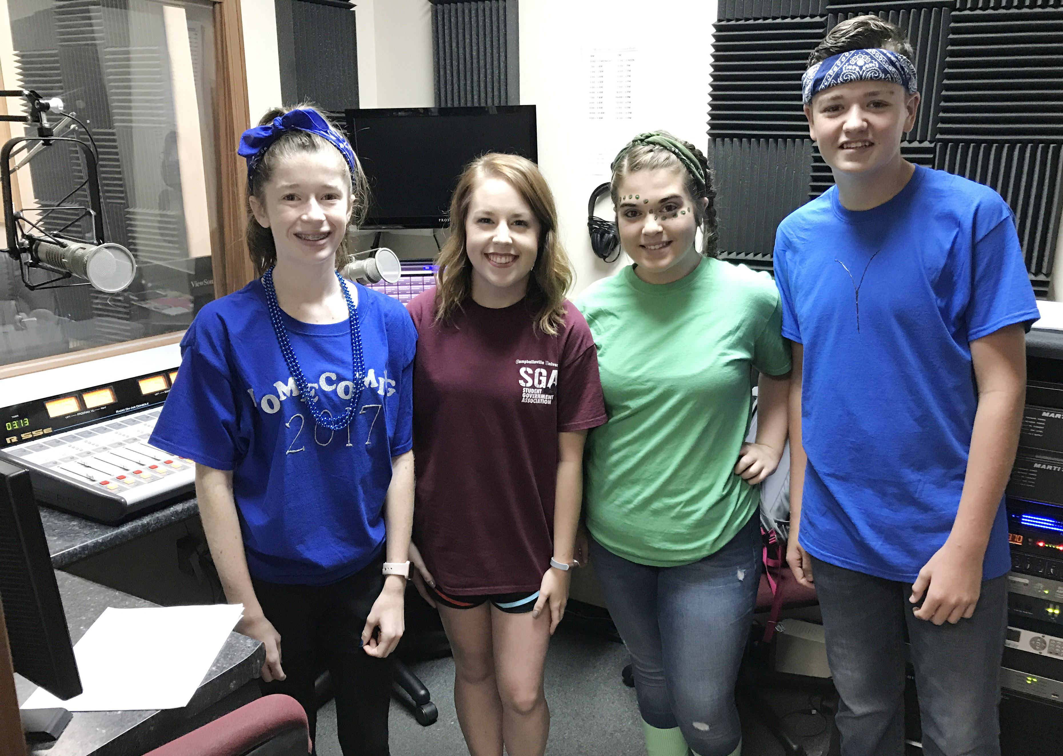 CHS sophomore Gracyne Hash, at left, freshman Chloe Garrett and sophomore Gavin Johnson, at right, are on the air each Thursday morning at 7:30 a.m. with Jess McCandless on WLCU-FM, second from left.