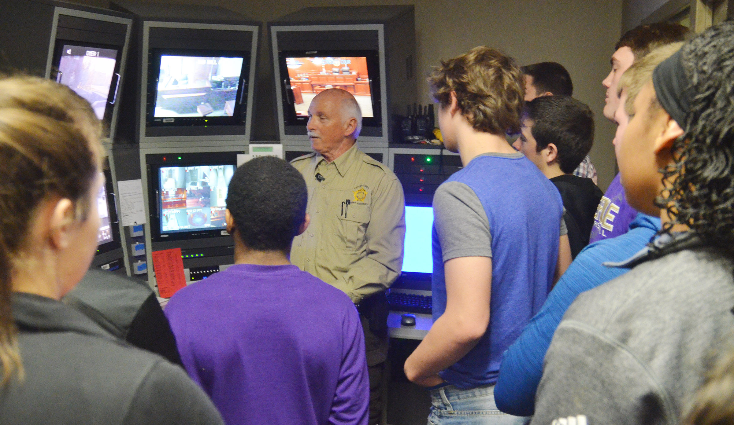 Kenny Anderson, a security officer at Taylor County Judicial Center, shows CHS sophomores how the security cameras record what happens at the judicial center.