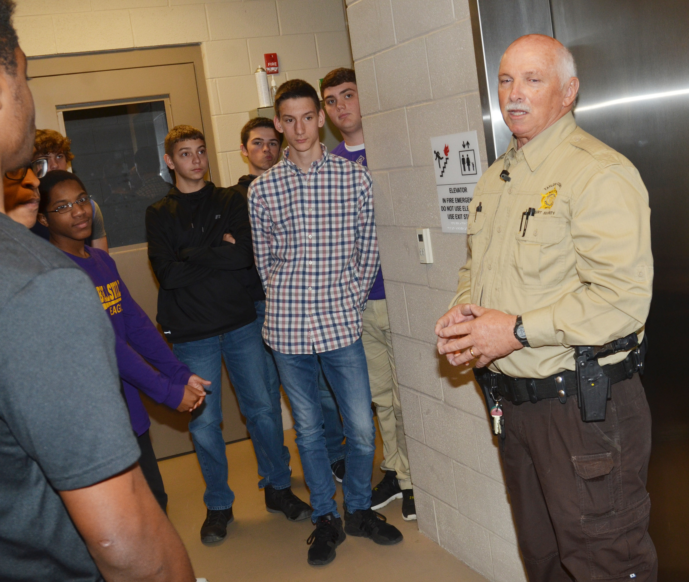 Kenny Anderson, a security officer at Taylor County Judicial Center, talks to CHS sophomores about how inmates are transported to appear in court.