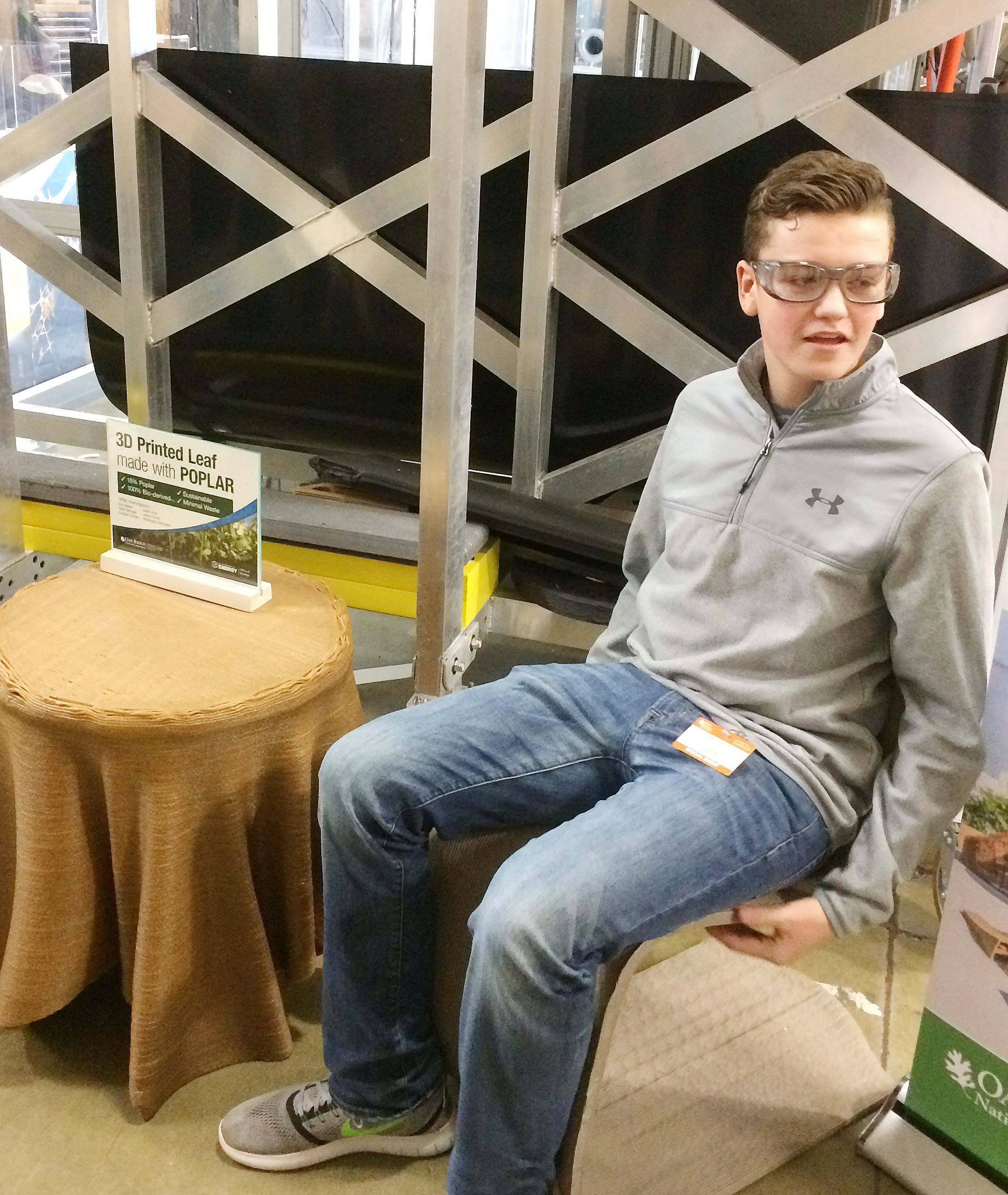CHS sophomore Gavin Johnson sits on a chair made with a 3D printer.